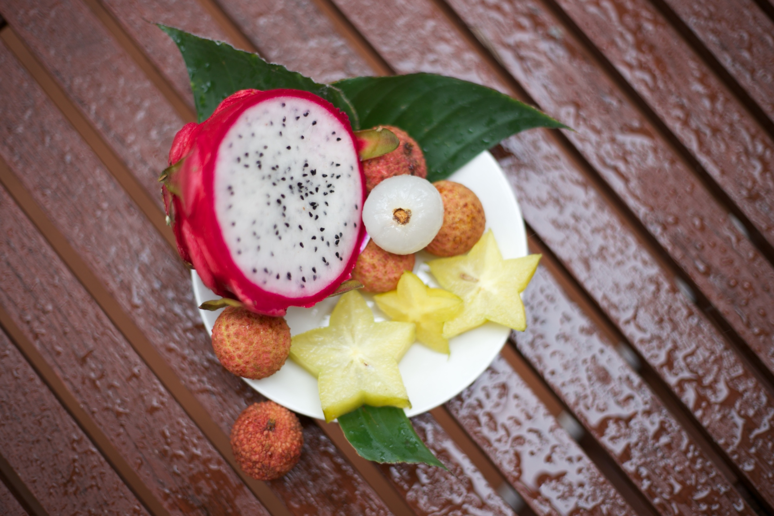 Tropical Australian fruit - dragon fruit, fresh lychees and star fruit.