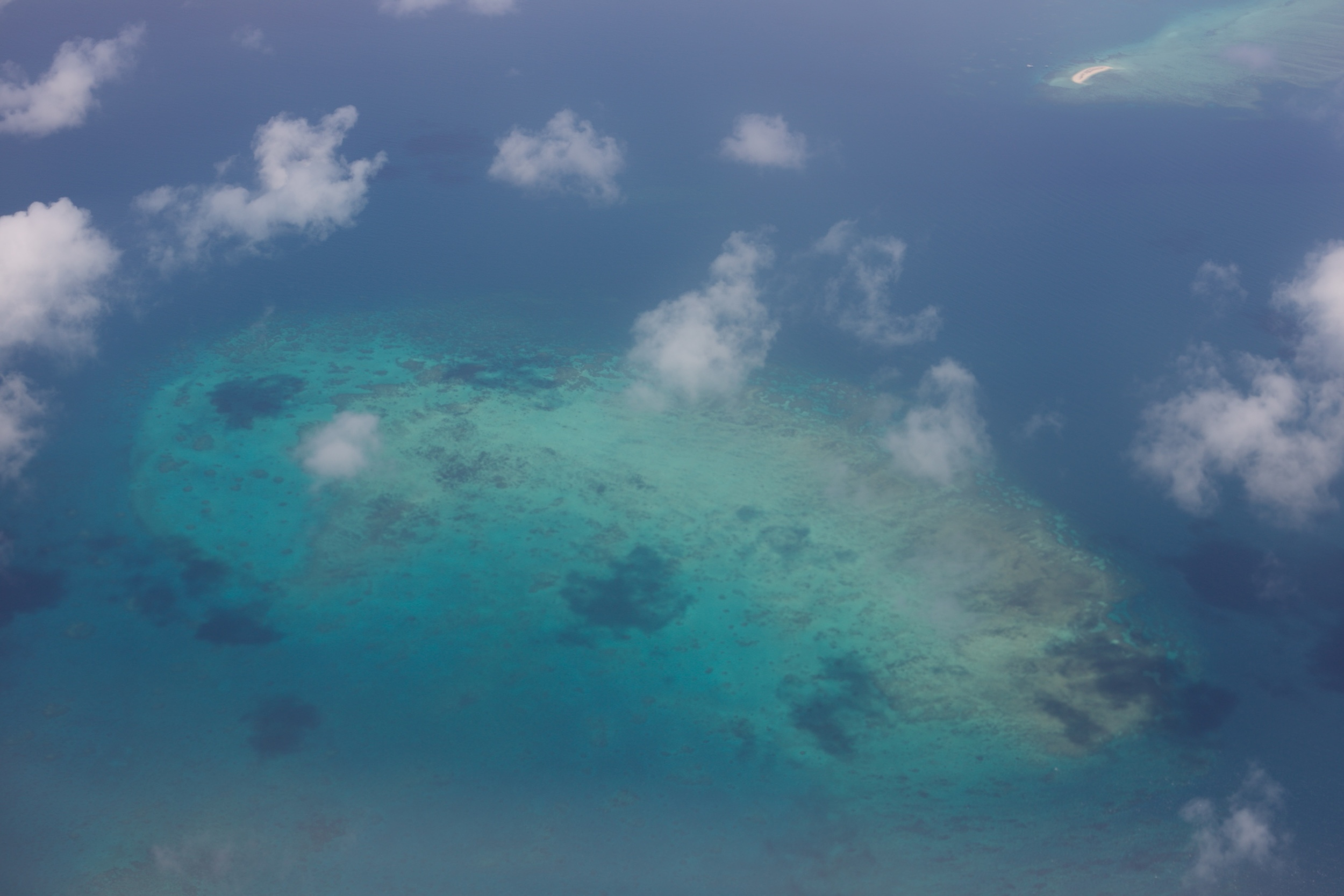 A small reef, part of the larger Great Barrier Reef, seen from a plane.