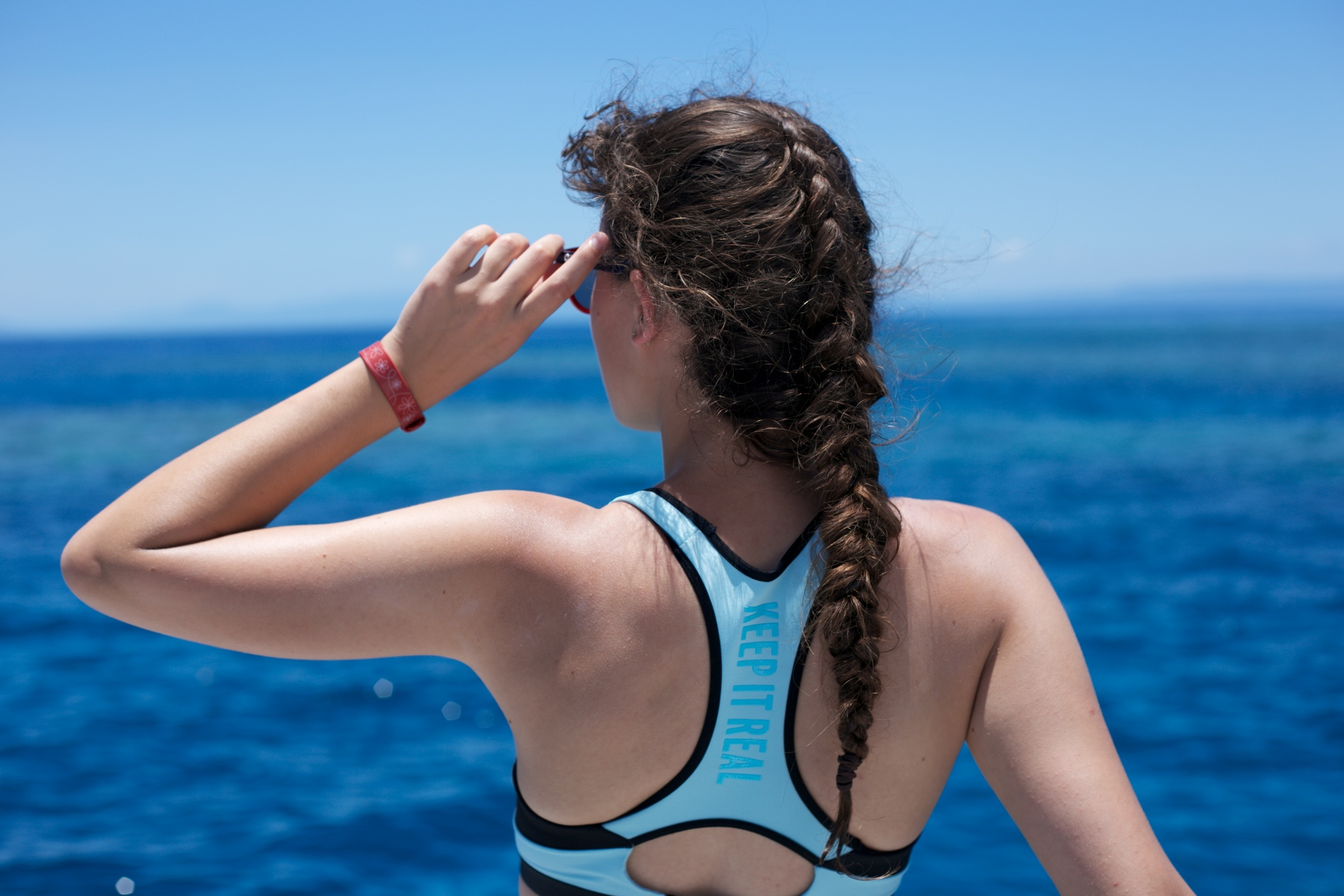 French braids and sunshine out by the Reef.
