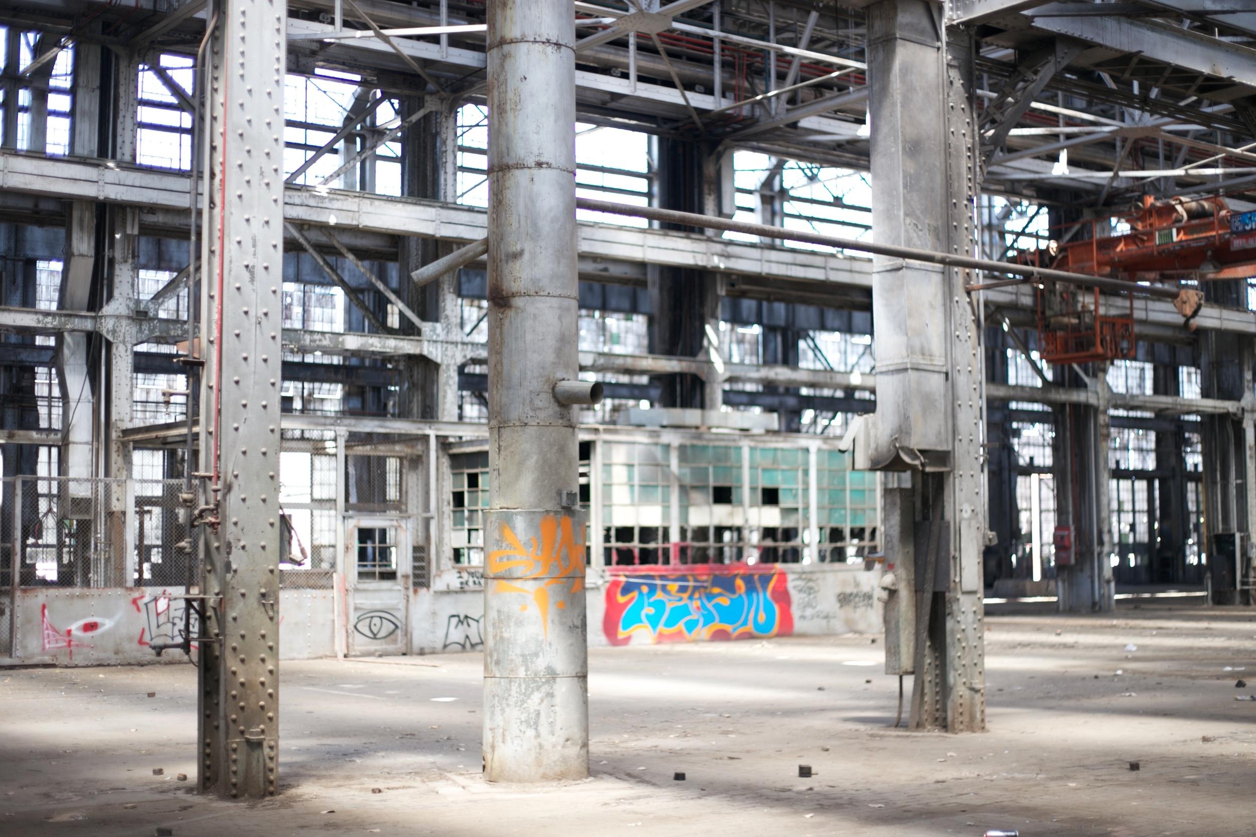 Pillars and graffiti inside the Rail Yards.
