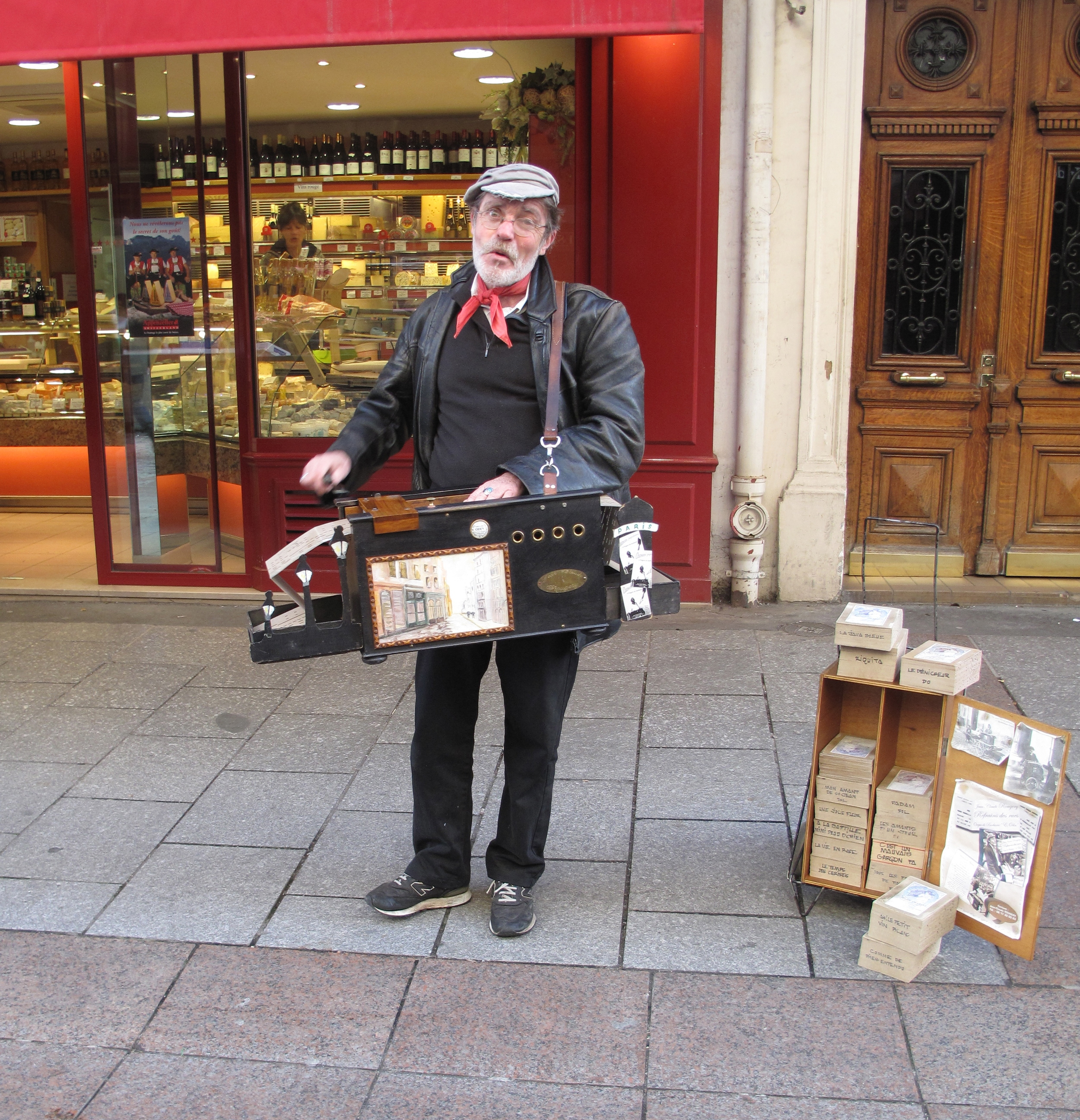 Busker playing a piano accordion in Paris