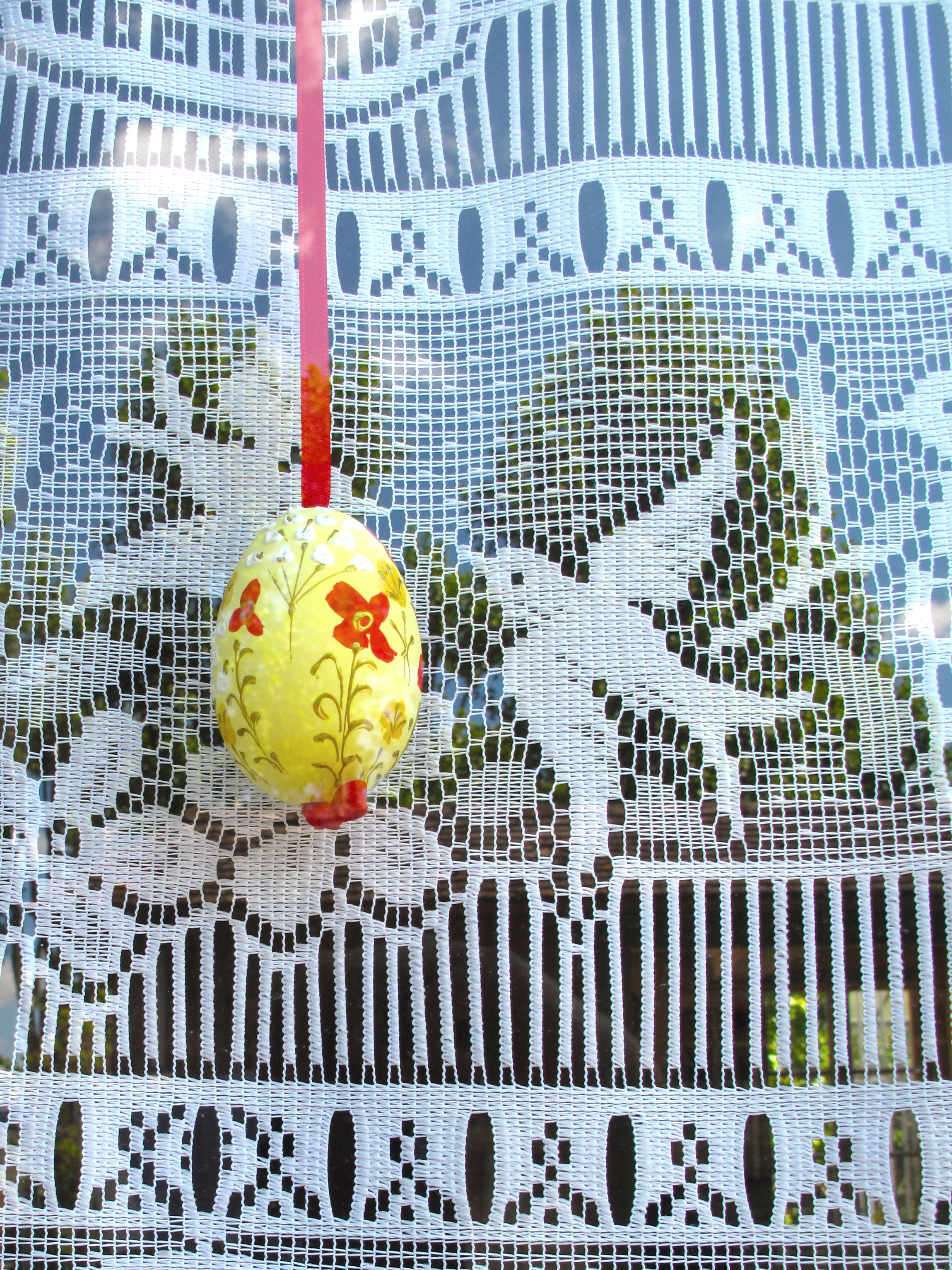 Easter eggs - blown and painted, in the window of an old house in Beauvais