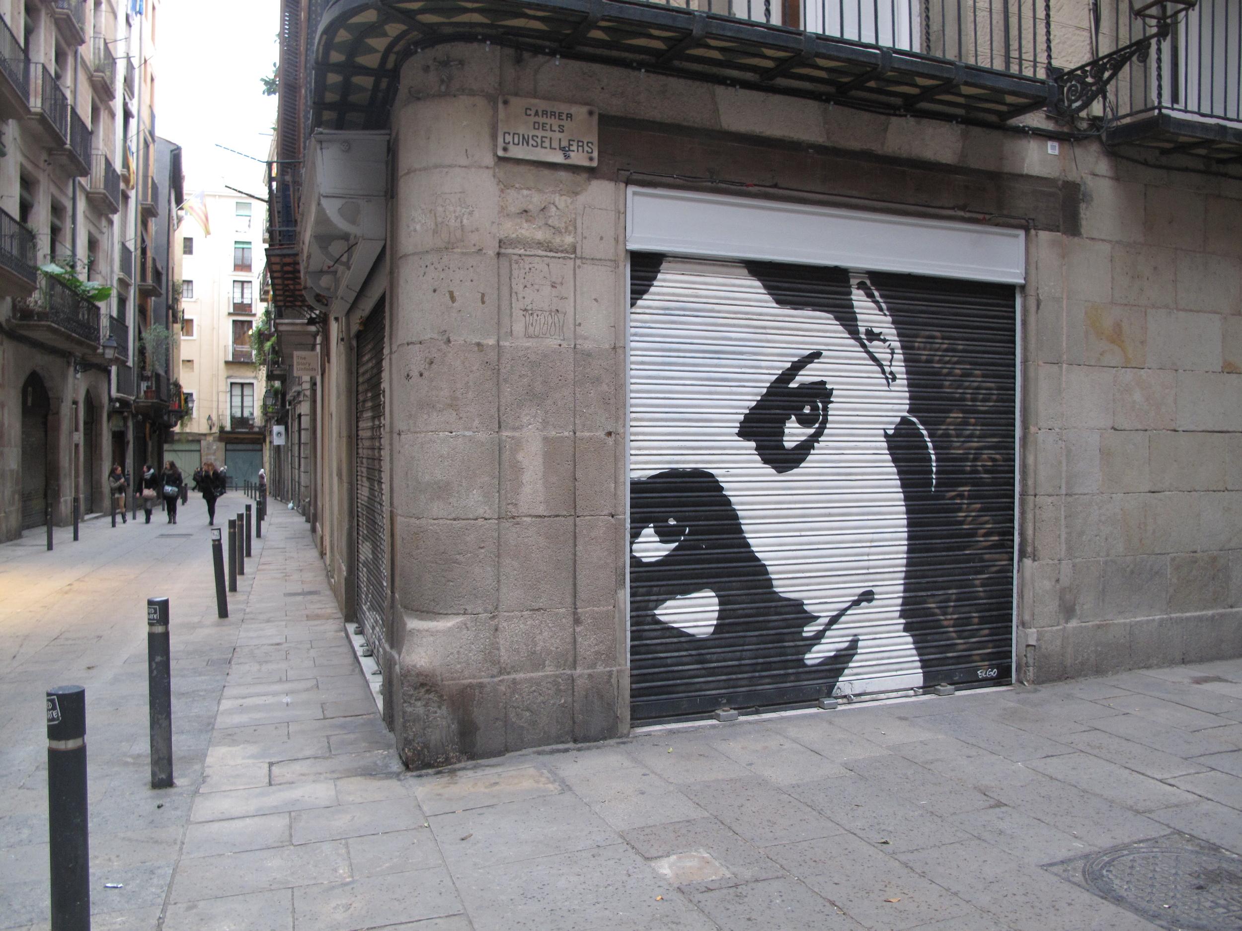 Barcelona street art - painting of a woman.