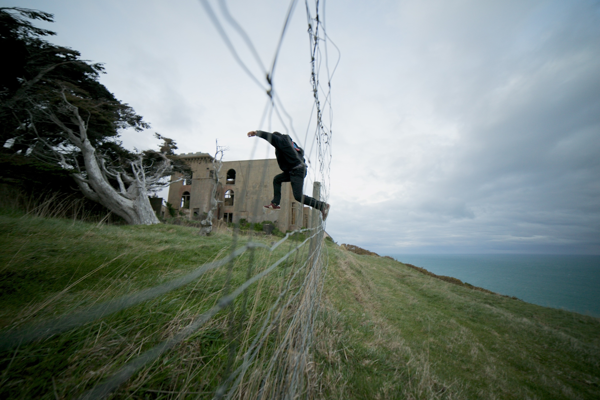 Oliver climbing the fence to Cargill's Castle