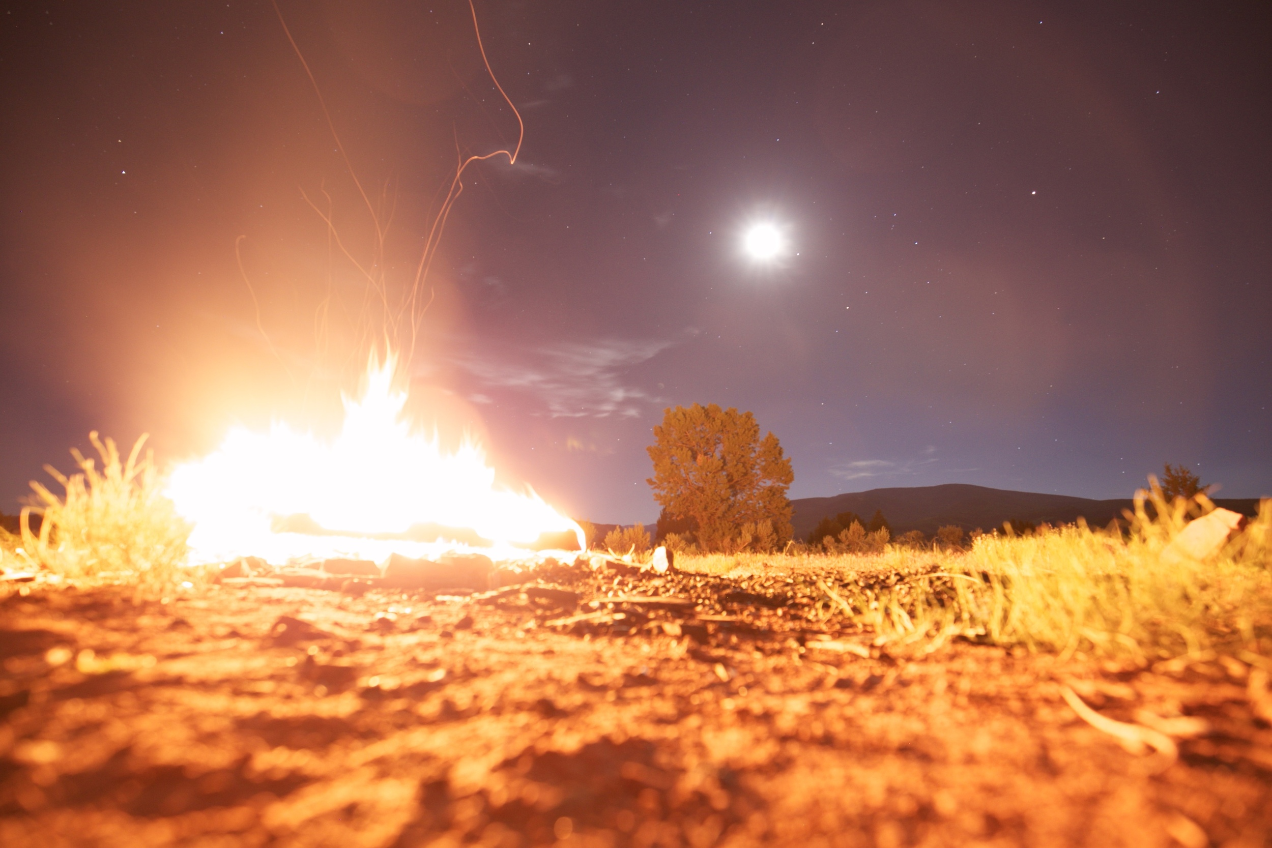 Midsummer midnight bonfire with the stars and a full moon.