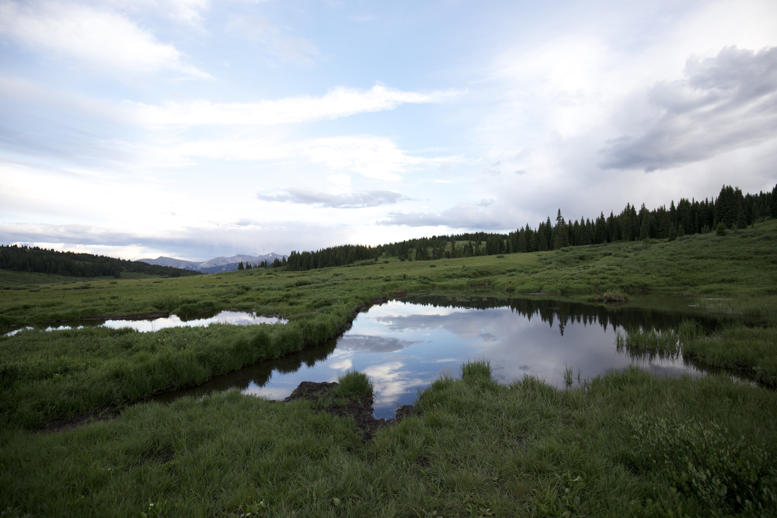 Clouds reflected in a pond, in the mountains of Colorado.