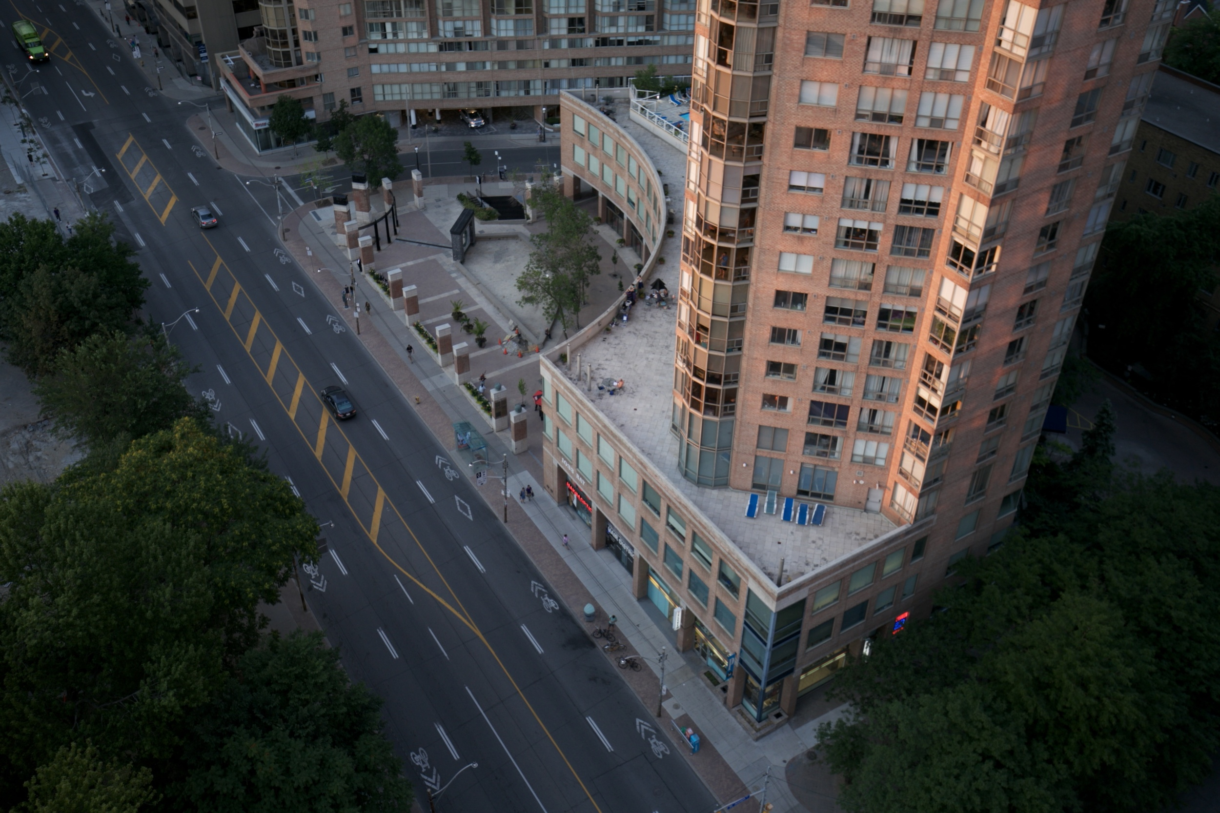 Looking down at the streets from a balcony in Toronto.