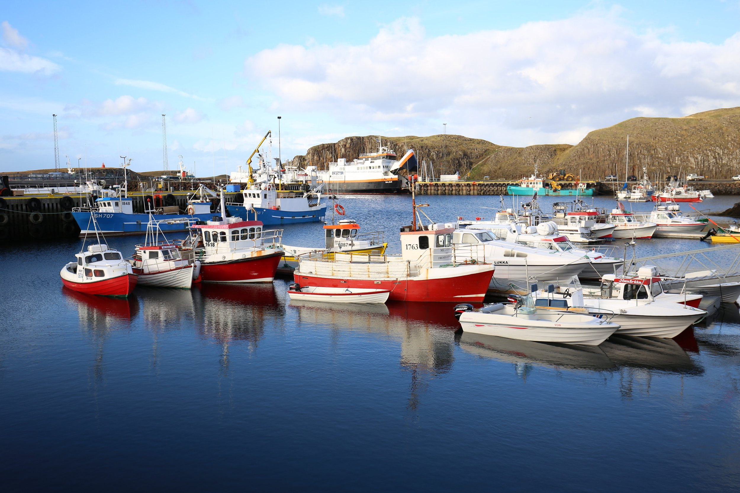 Stykkisholmur Iceland colourful boats in the harbour