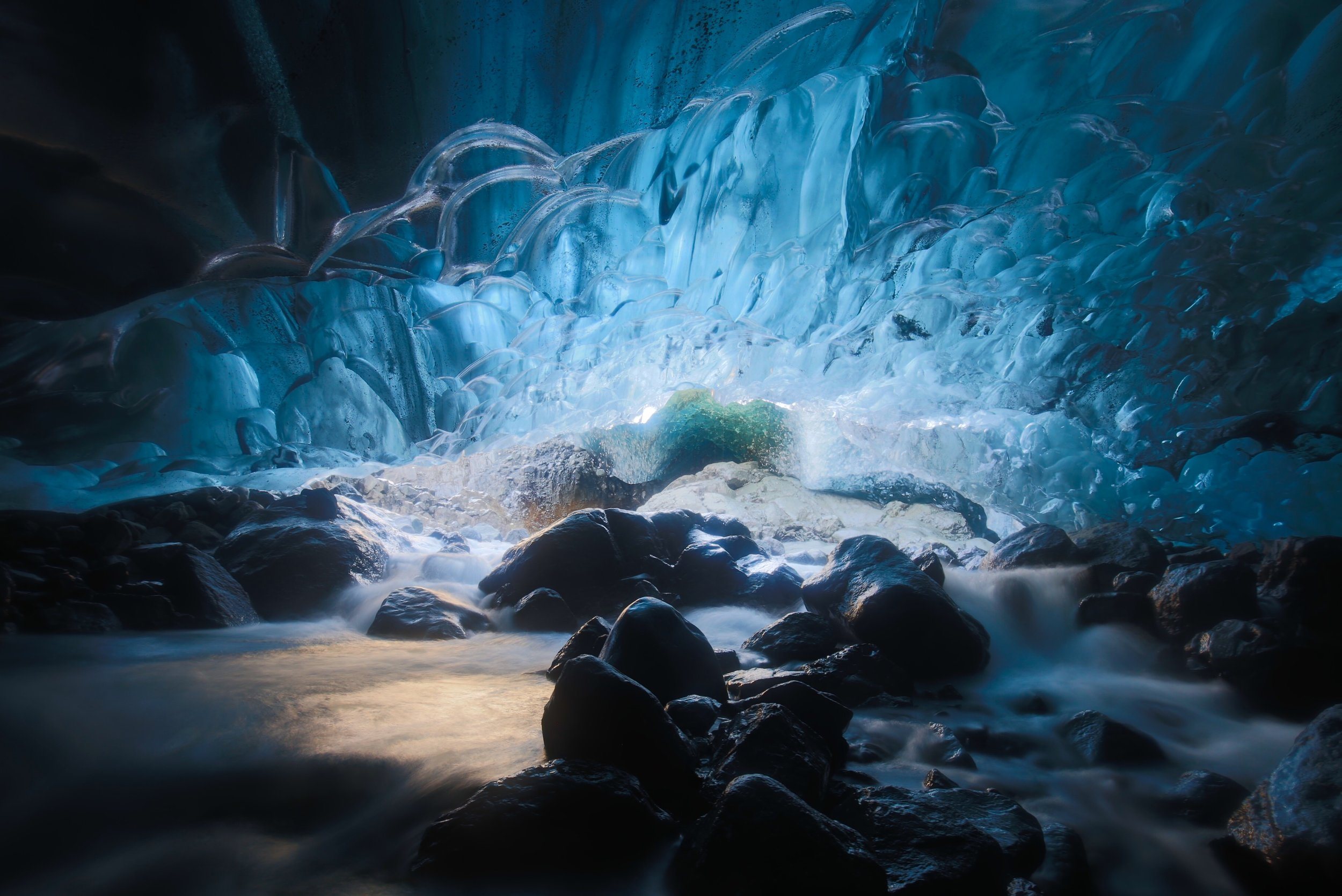 colourful blue luminous ice cave