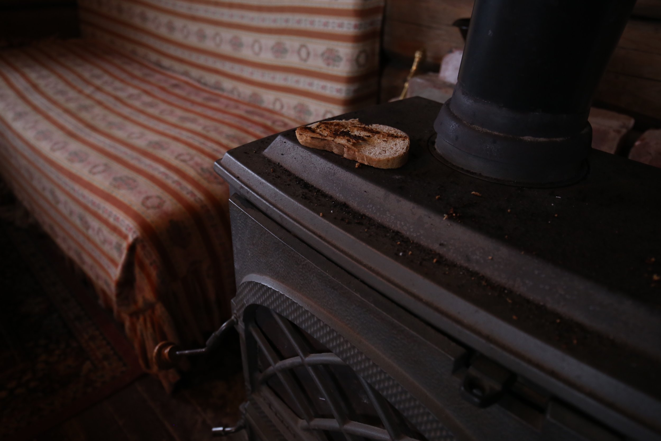 toasting bread on fireplace