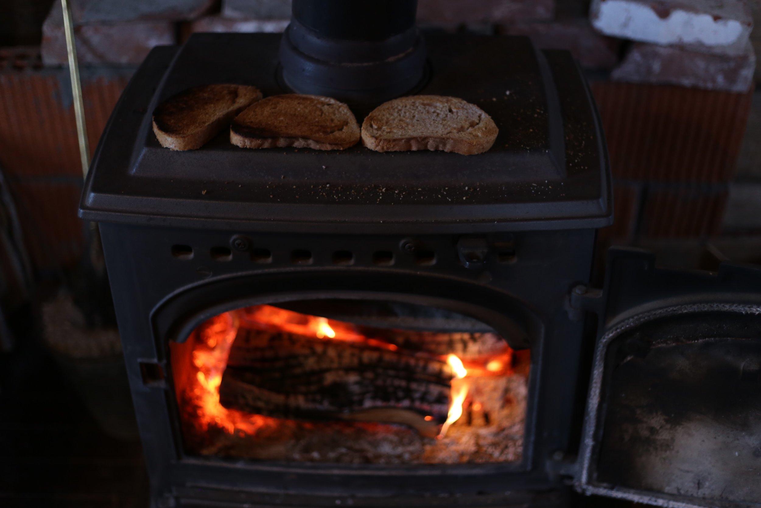 making toast on fireplace