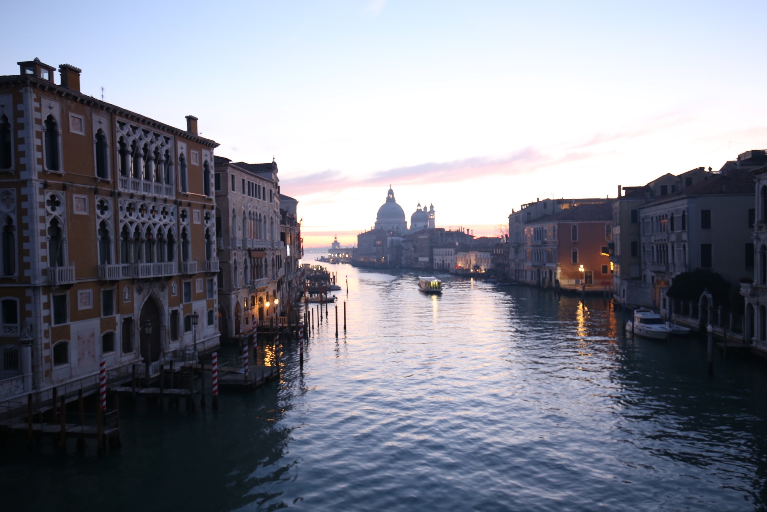 The sun peeks out over the Grand Canal, view from the Pont dell'Accademia.