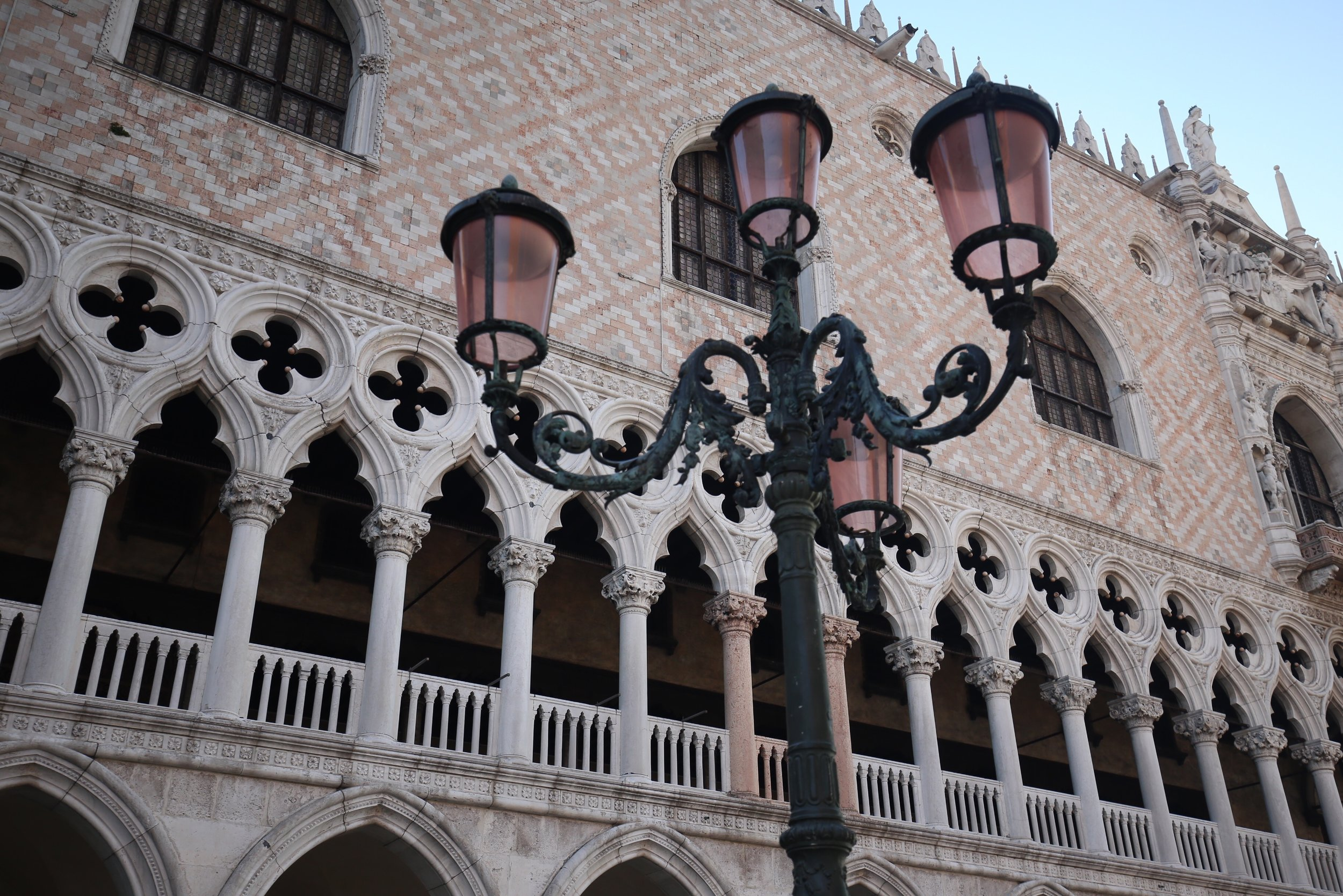 Pink lamp by the pink stone pillars of the Doge's Palace in Venice.