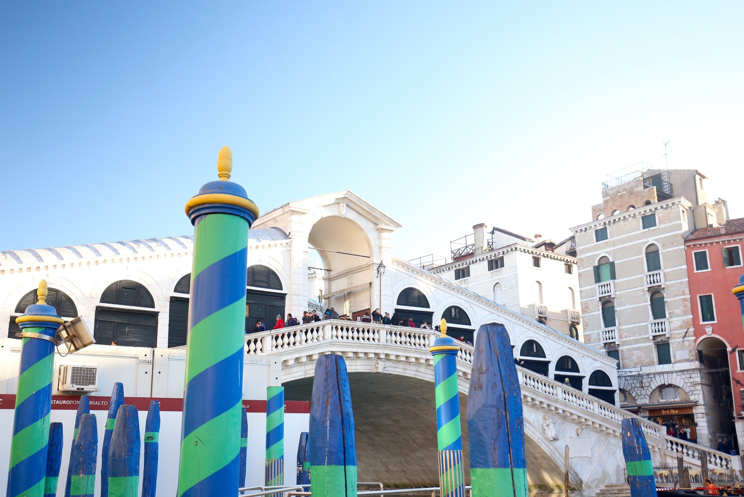 Rialto Bridge and blue and green bricoles by the Grand Canal.