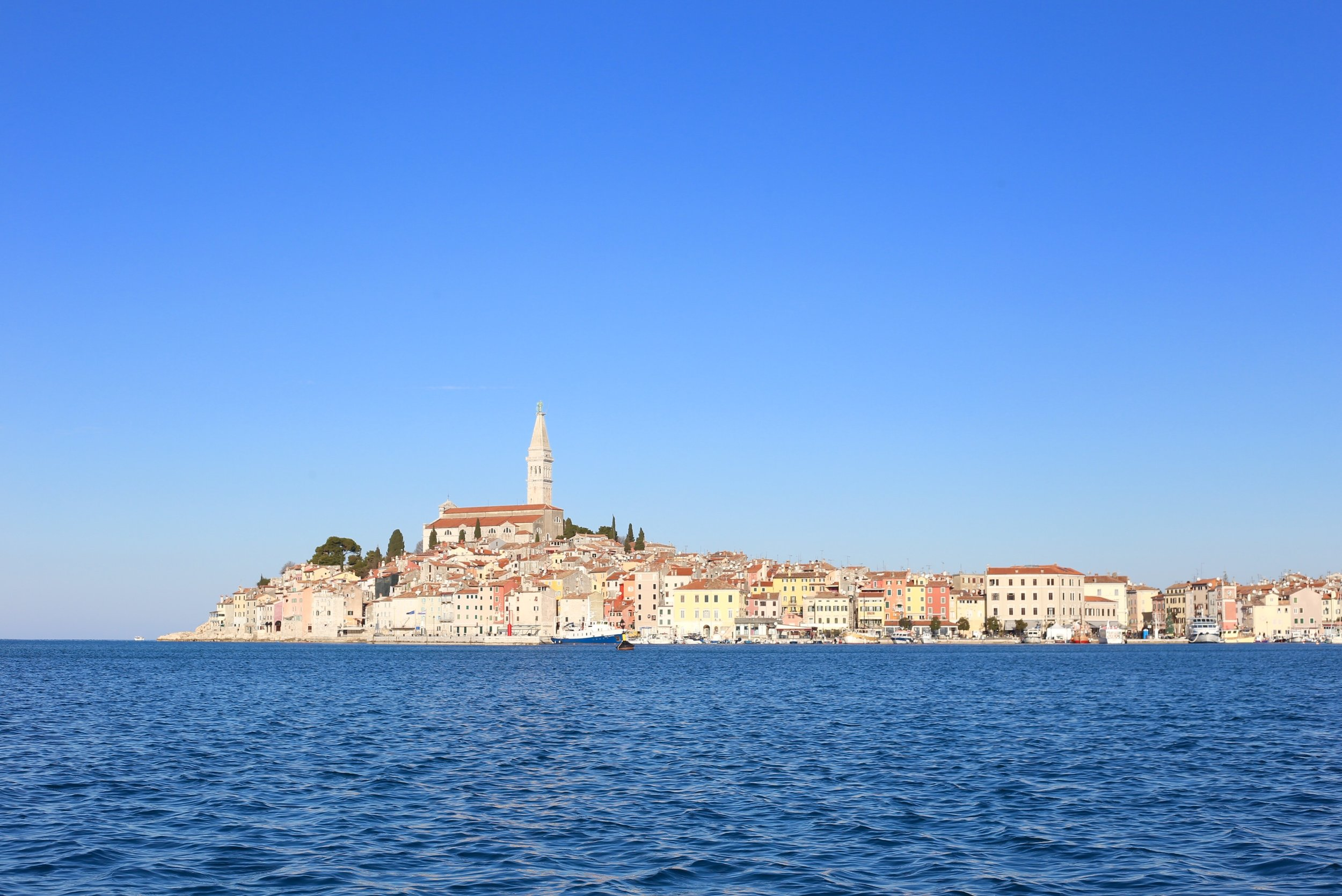 Blue sea and sky by Rovinj peninsula - a town sticks out in the sea.