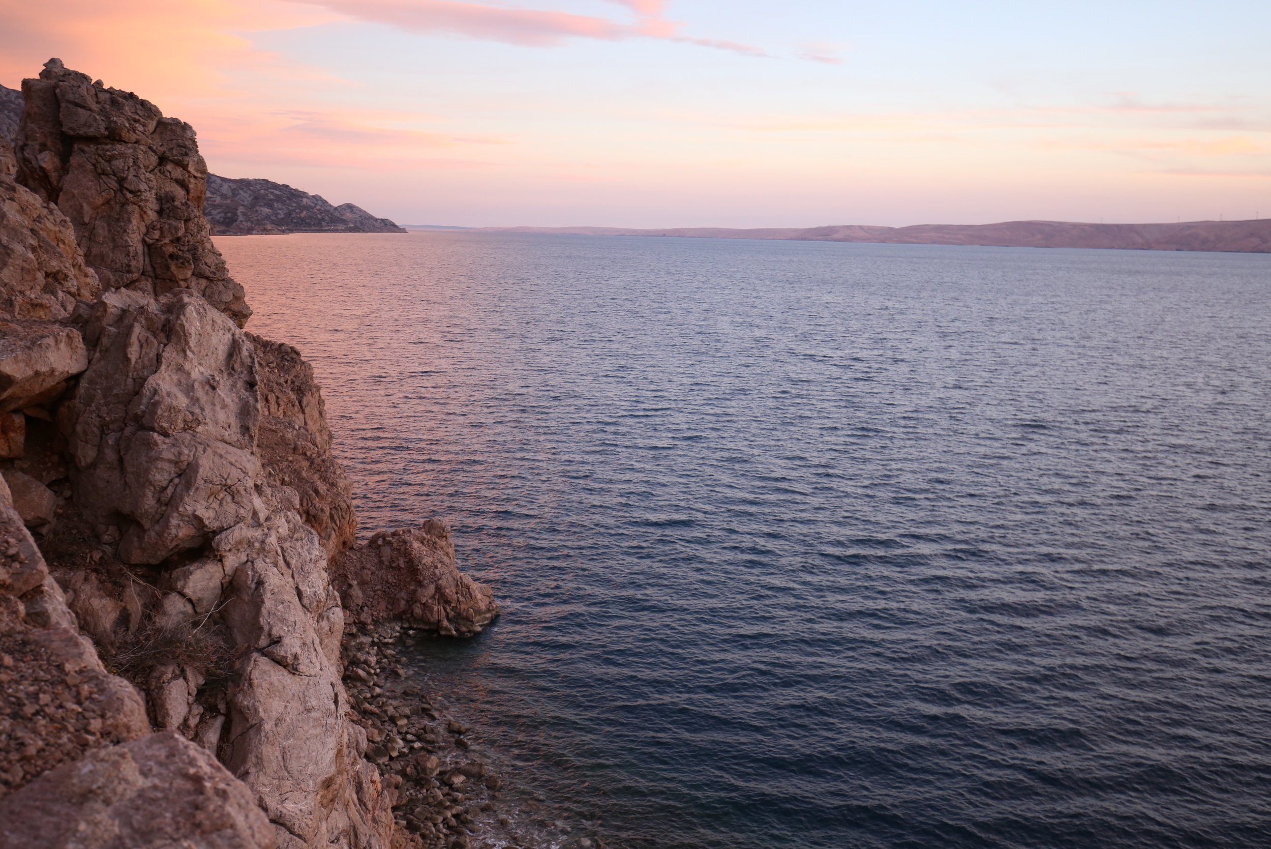 Sunset by the rocky coast of Croatia