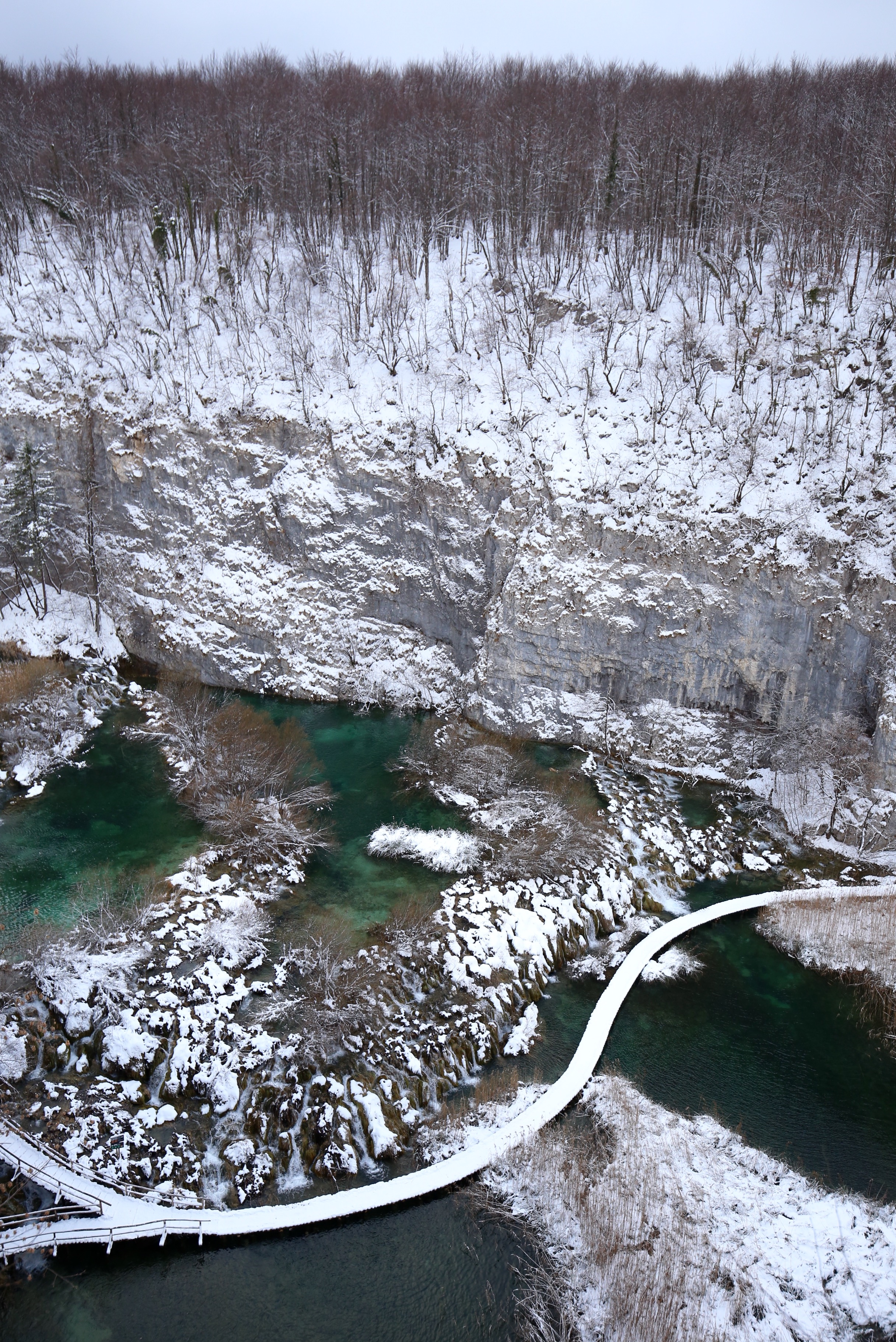 Plitvice Lakes National Park in winter, covered in snow.