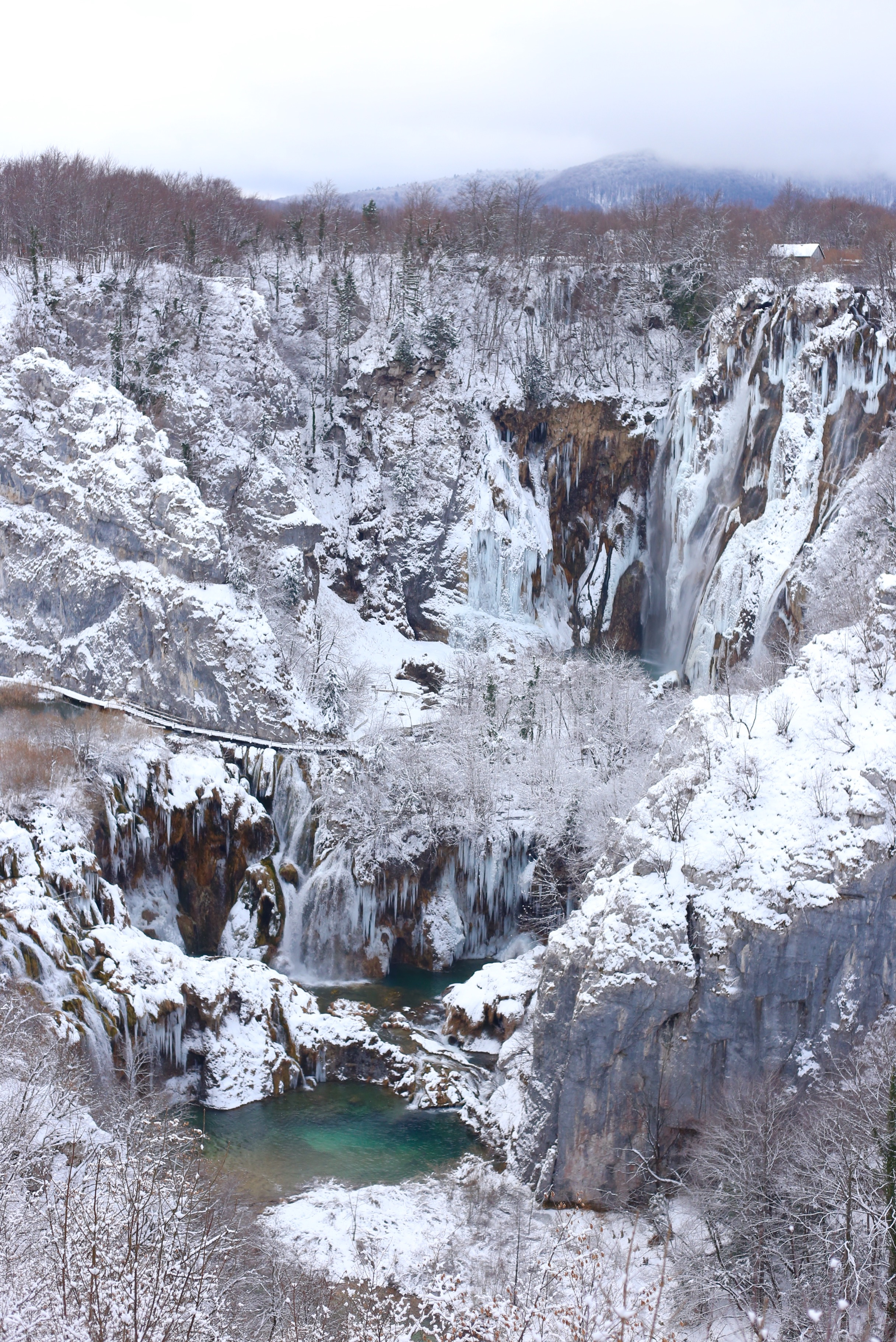 The lower lakes of Plitvice Park in winter. The pools are very blue.