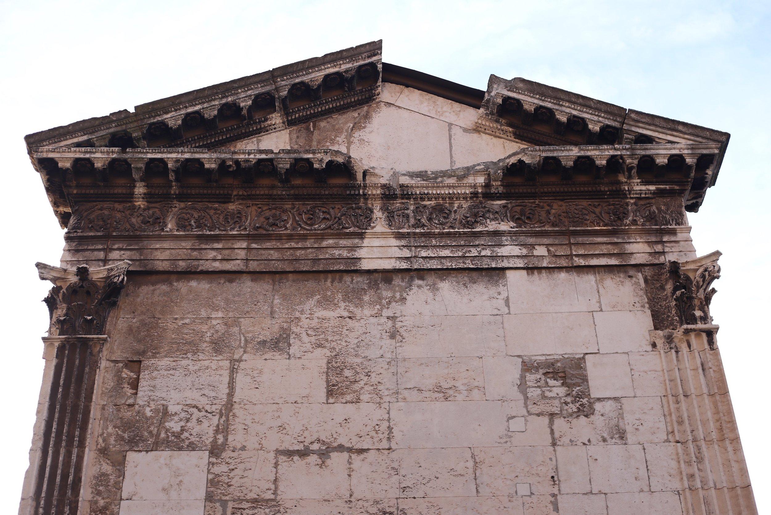 Roman tympanum on the Temple of Augustus, Pula.