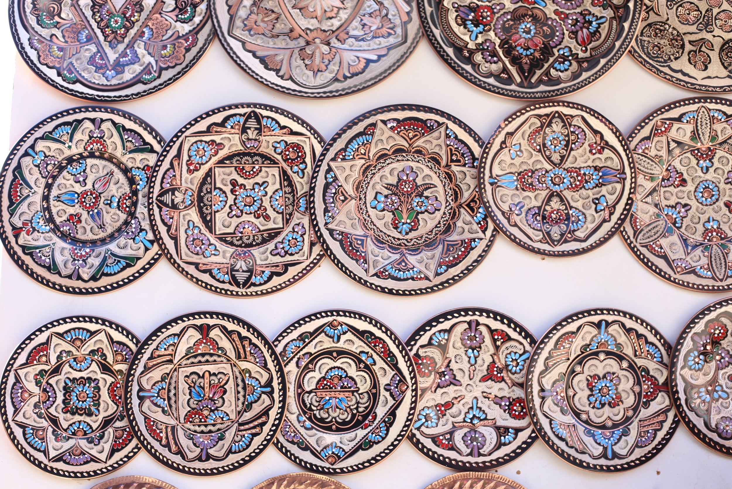 Moorish metal plates painted with many patterns.
