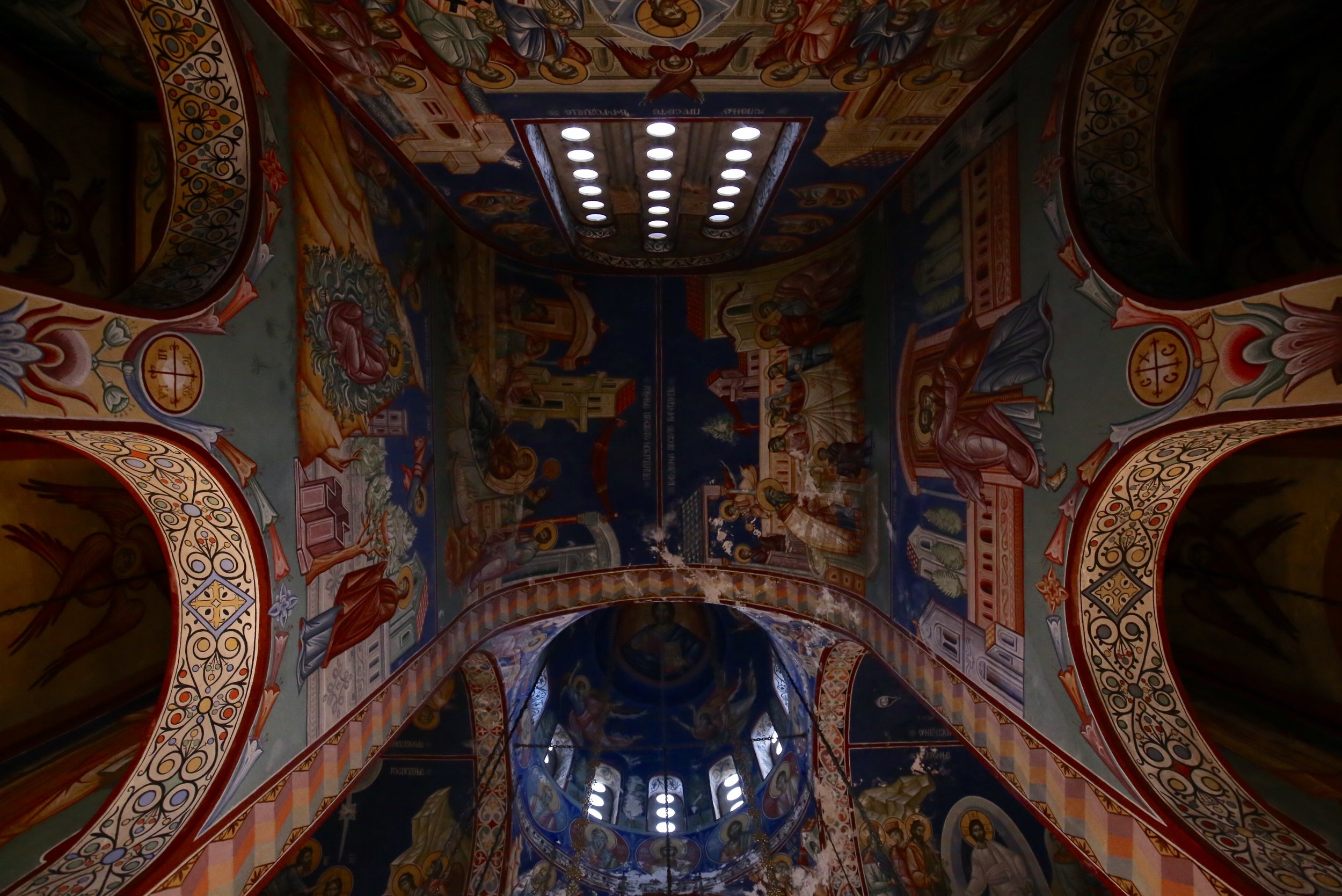 The interior of Hercegovačka Gračanica Church - painted ceilings and saints.