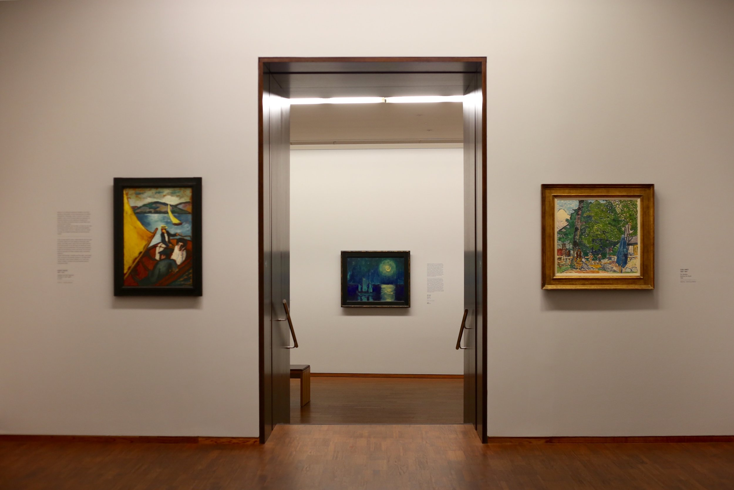 Art museum with paintings hanging on the walls.