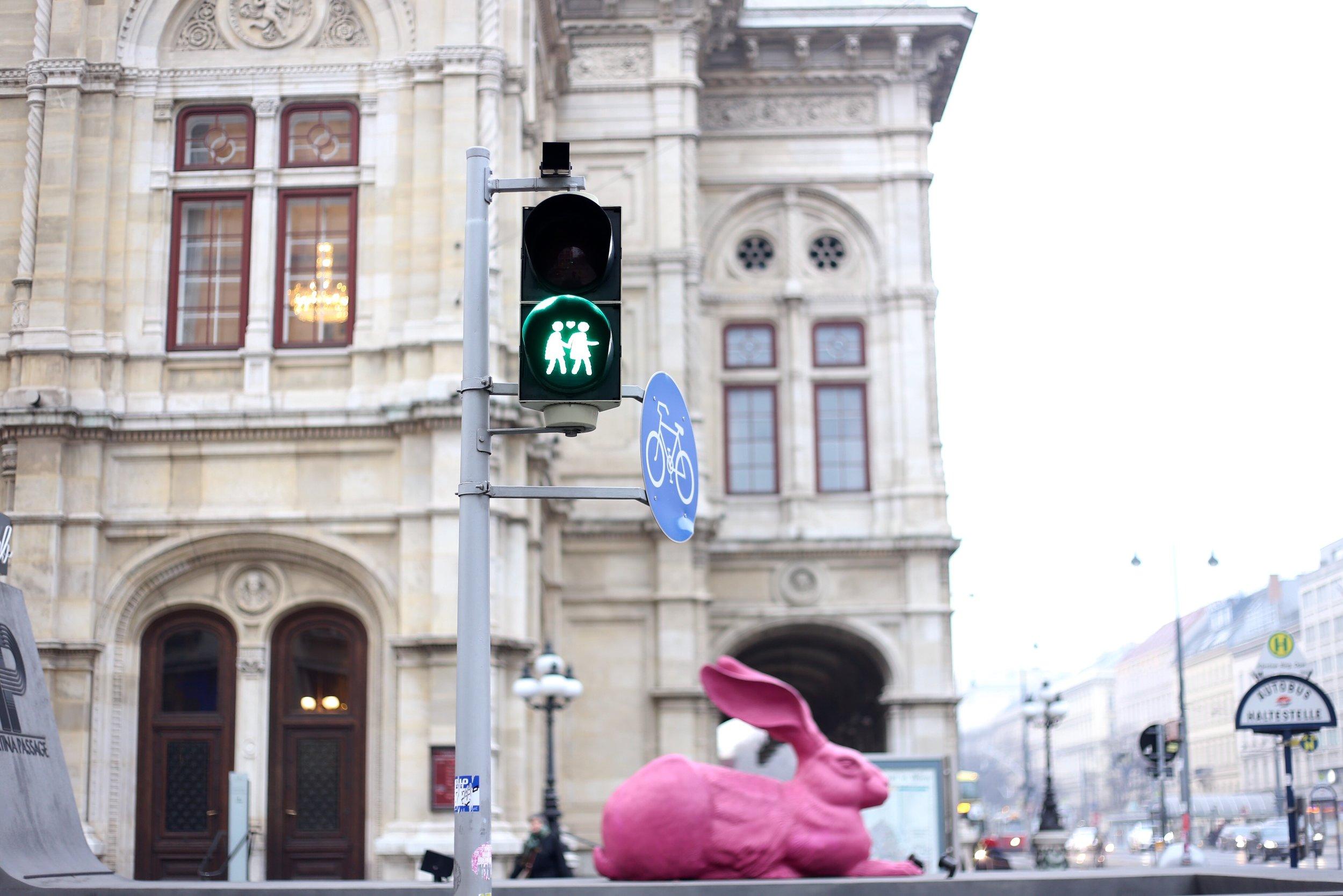 Crosswalk lights with love hearts.