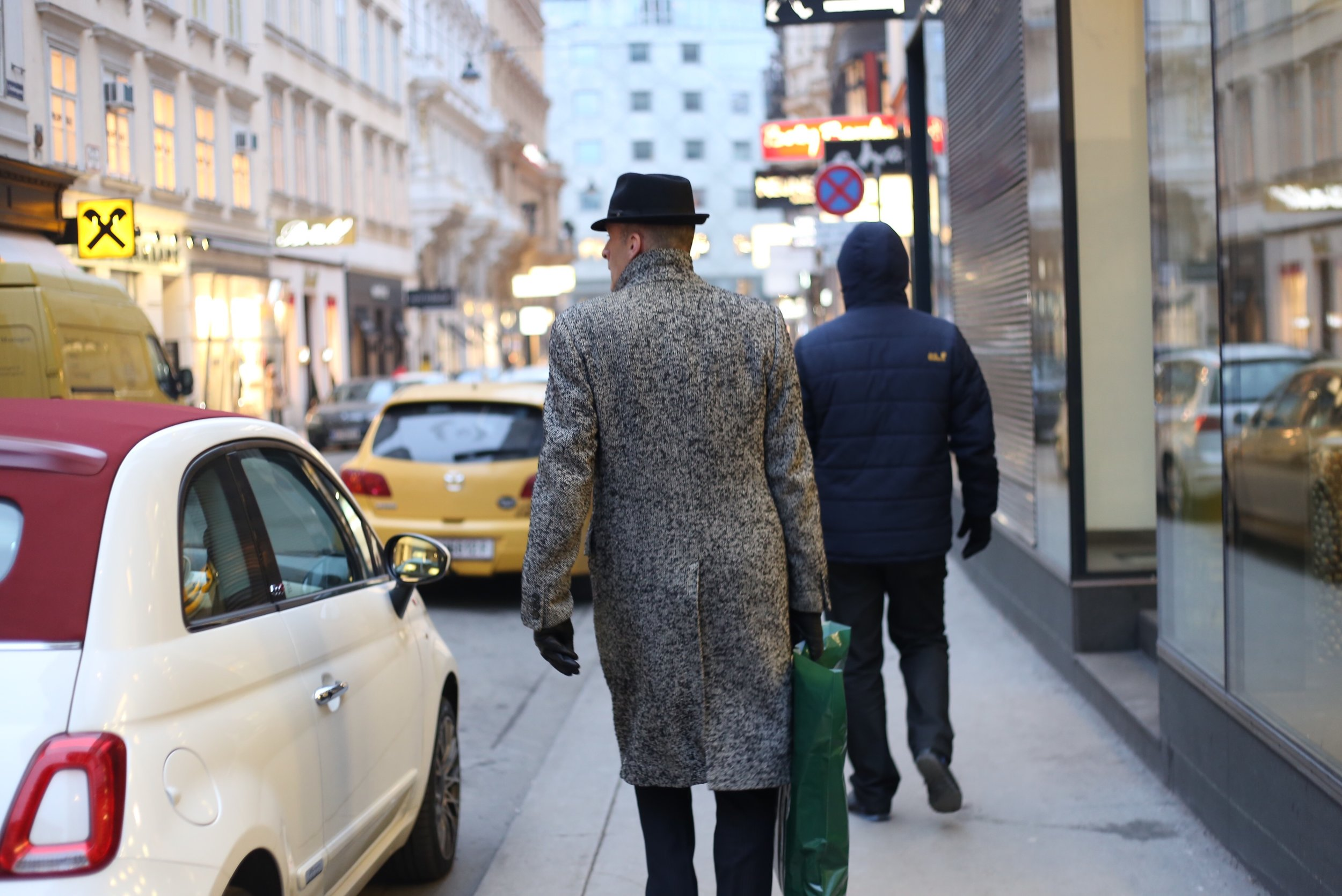 Man in a tweed coat and hat.