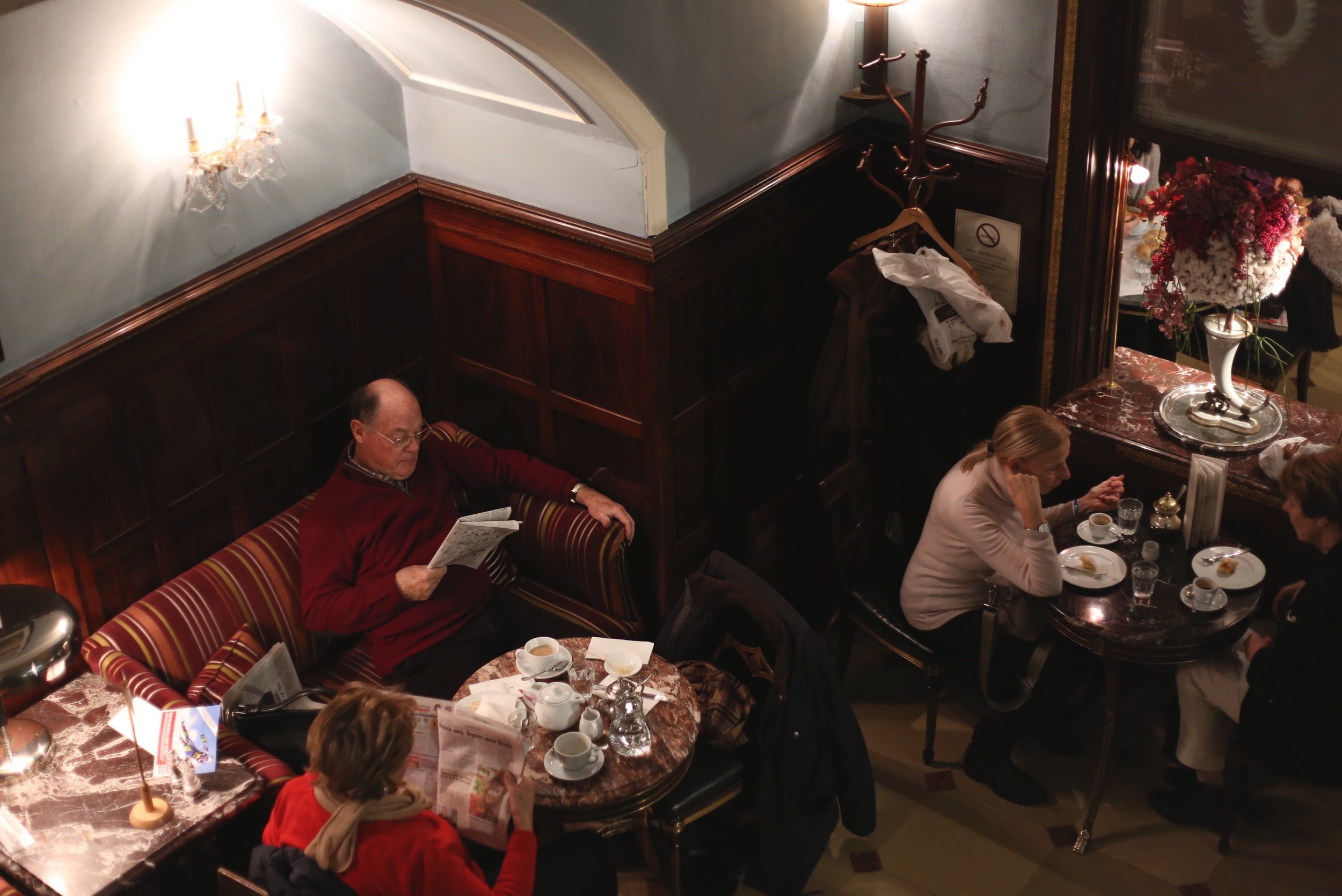 People reading the paper in Demel pastry shop, Vienna.
