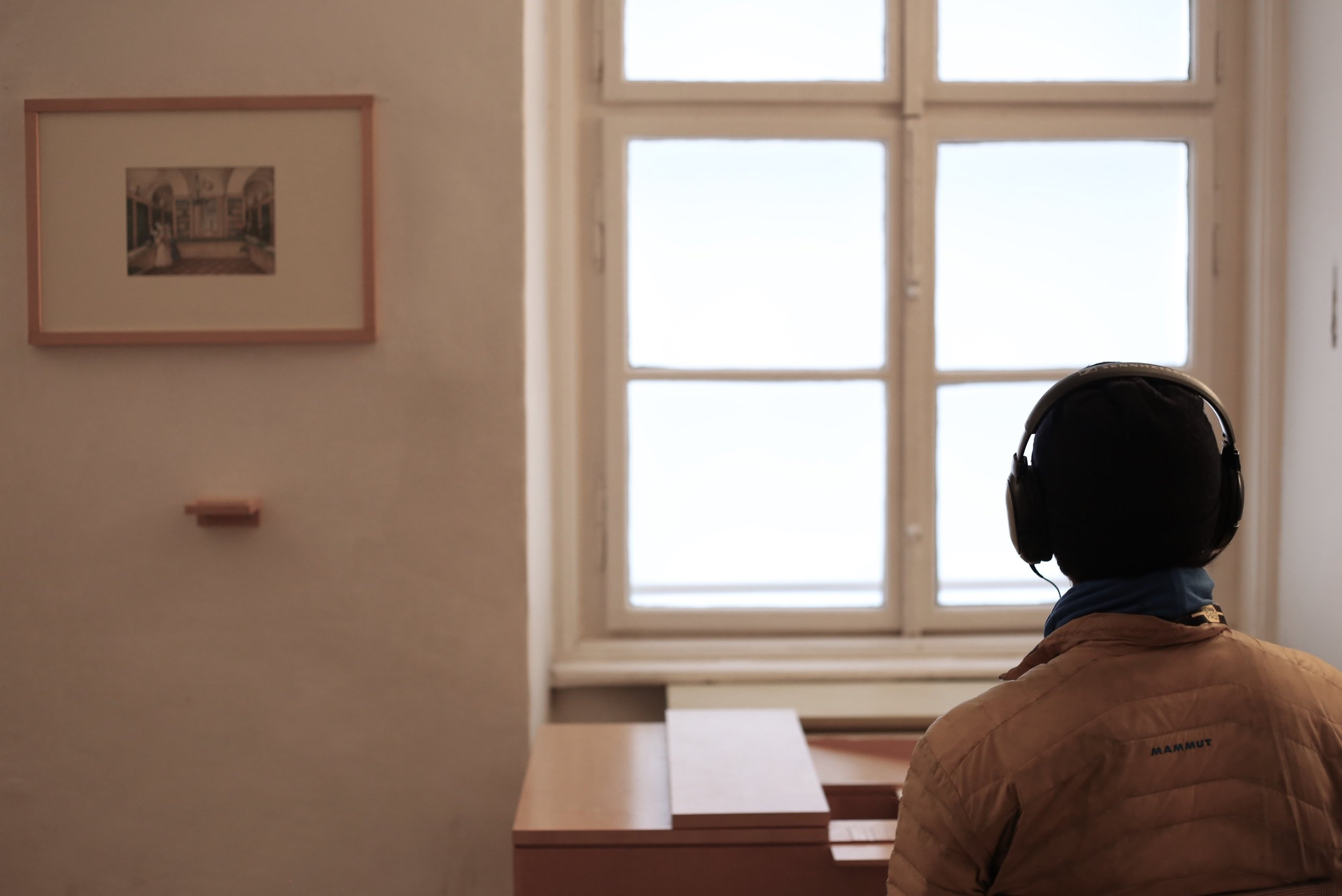 Ollie listening to music through headphones in Beethoven's house