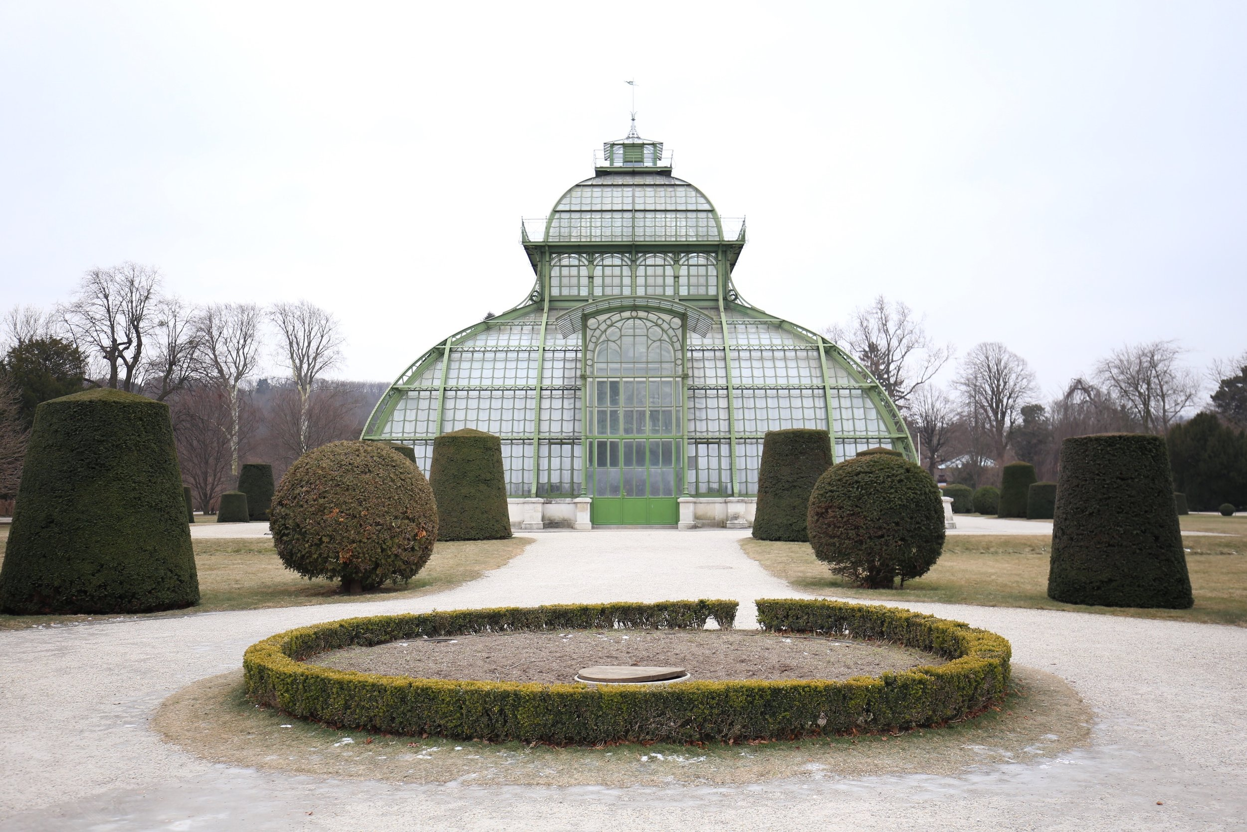 glasshouse and topiaries