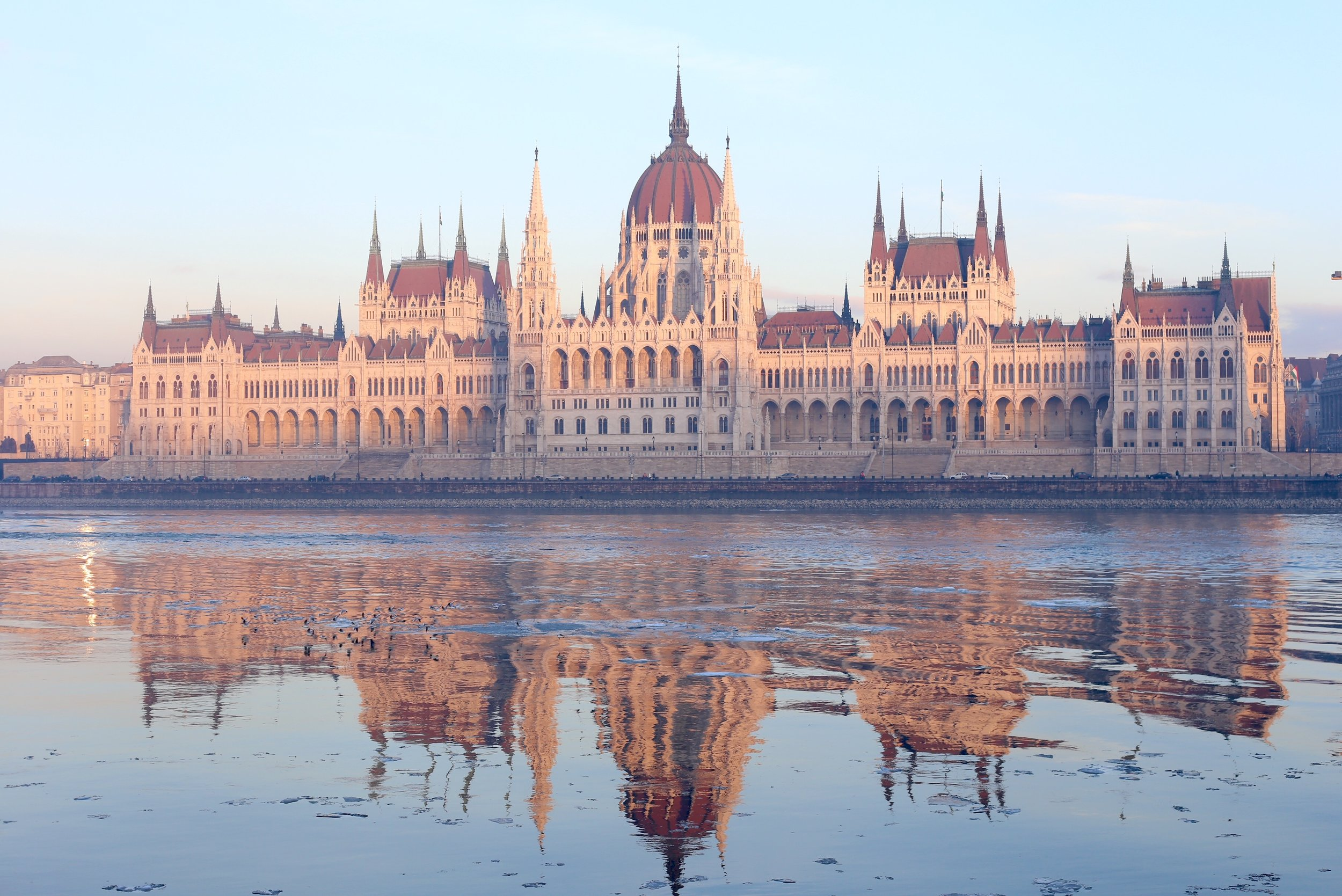 Grand Budapest - the Parliament Buildings in the early morning, reflecting the gothic spires in the Danube.