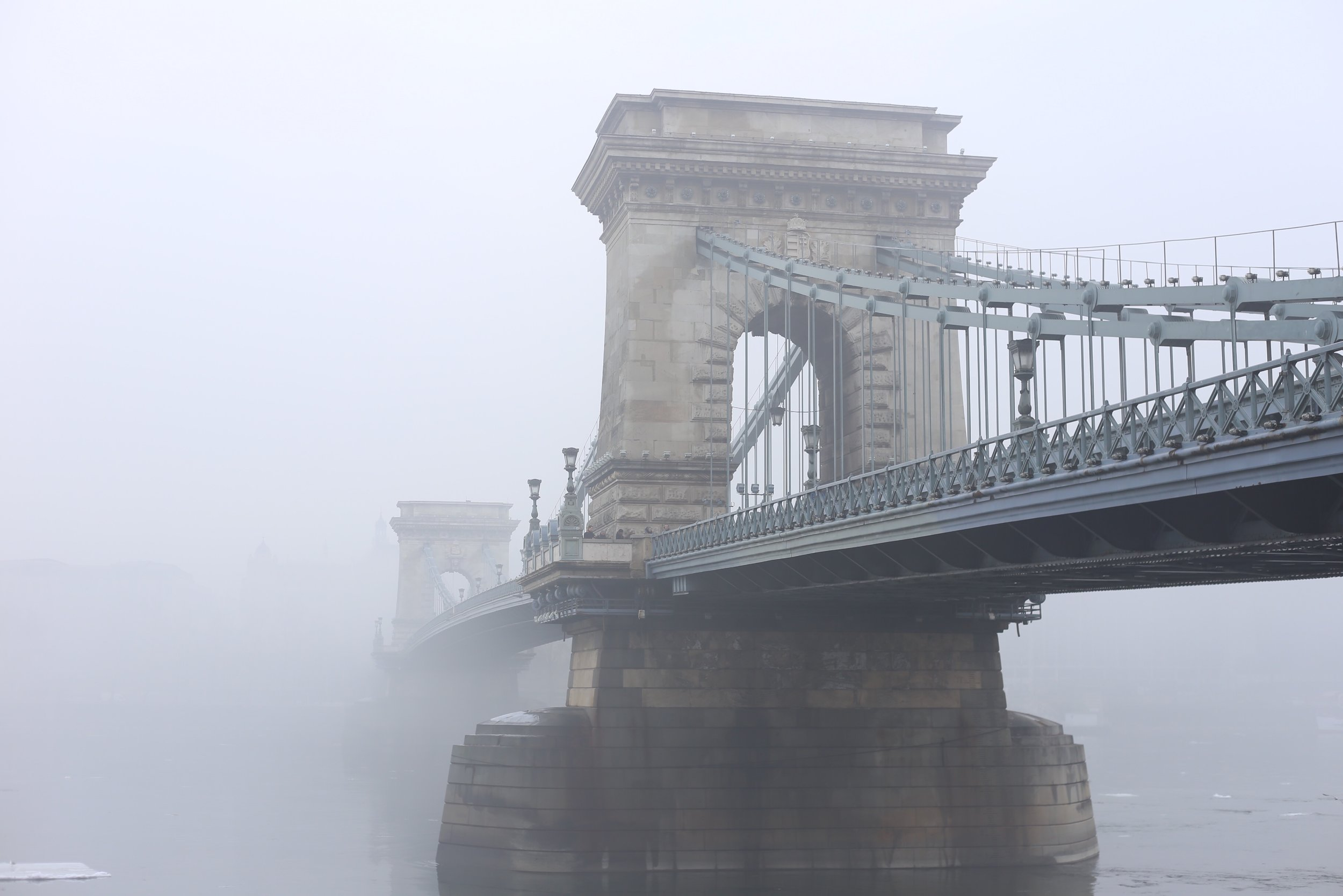Chain Bridge emerges from the mist.