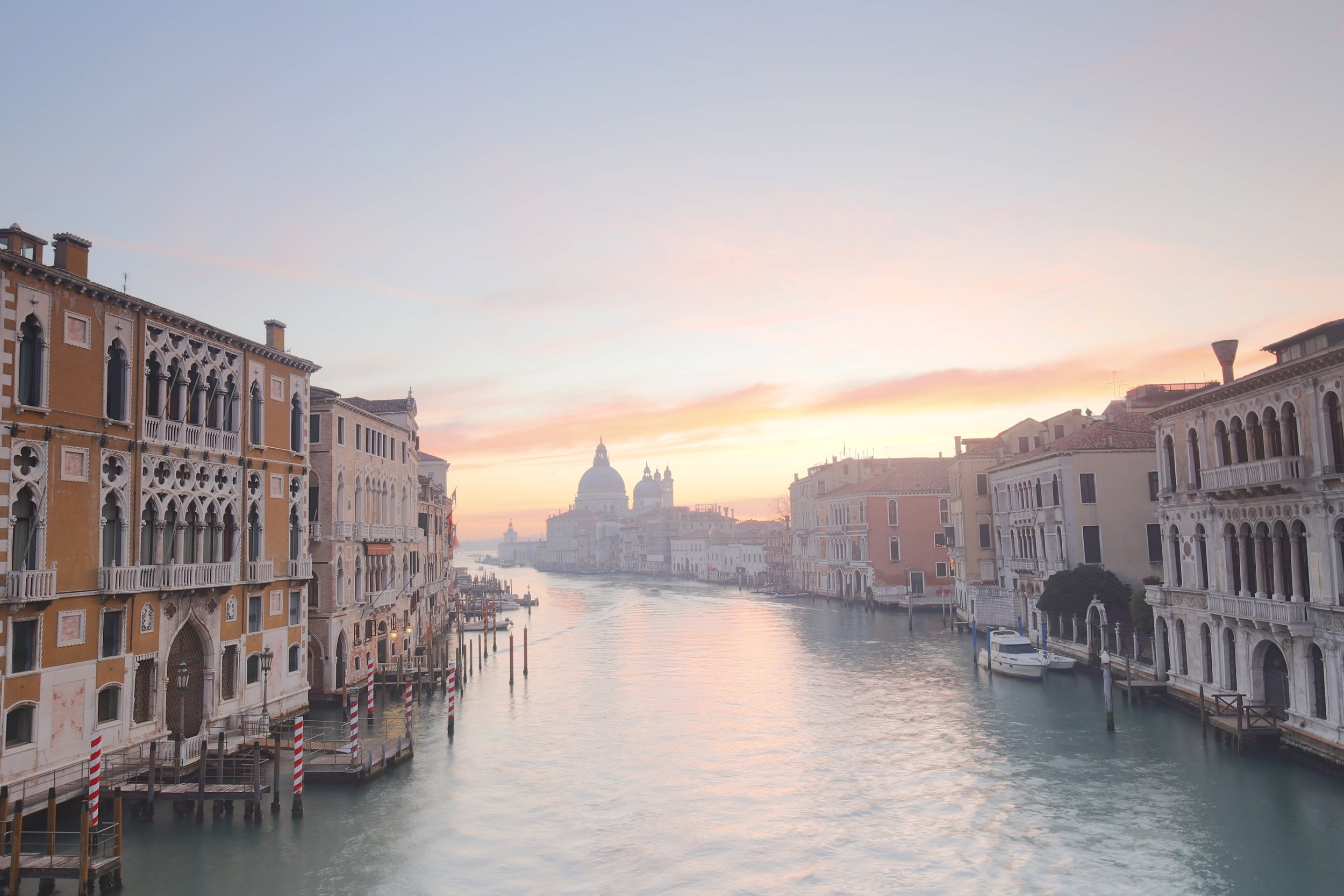 A beautiful Venice sunrise from the Pont dell'Accademia - with pink water and sky.