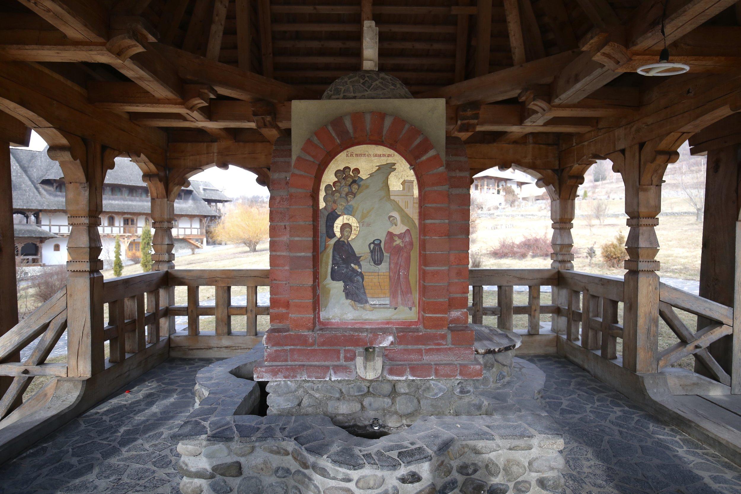A small shrine over a spring, inside a Romanian monastery.