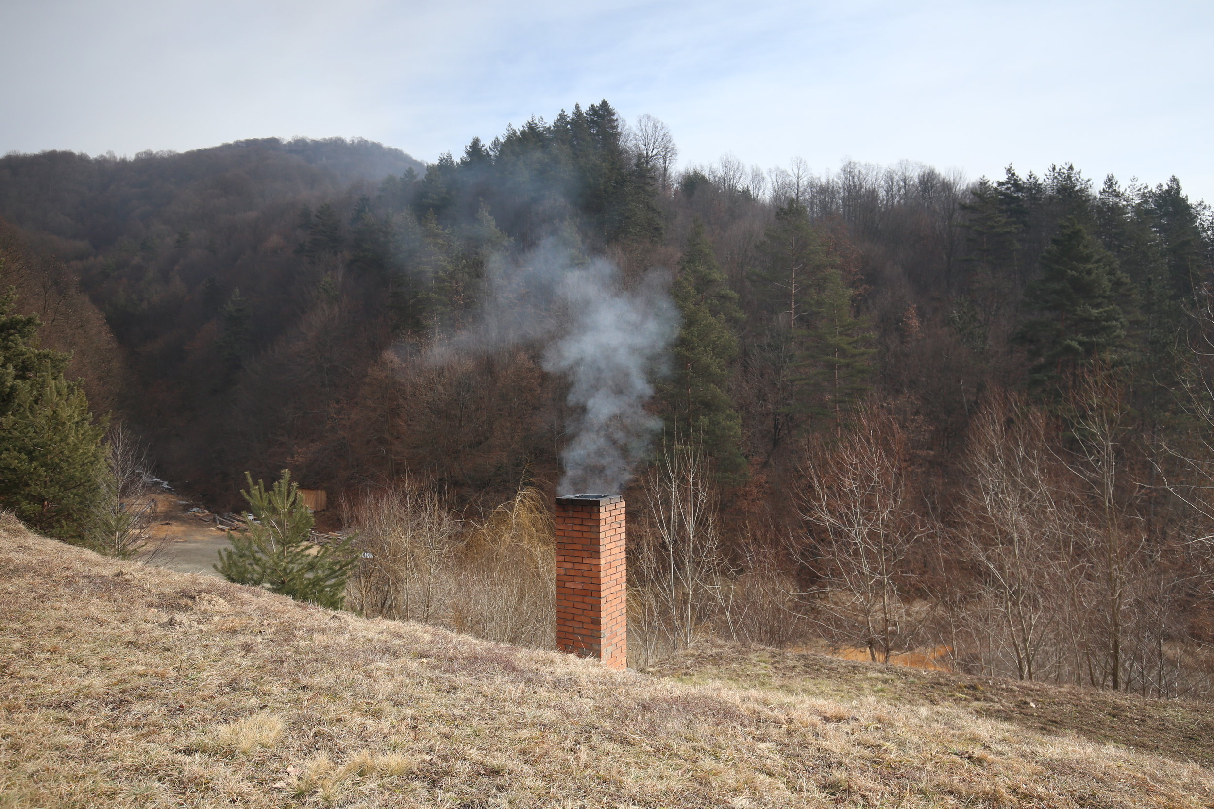 A chimney smoking in the hills of Maramures, Romania.