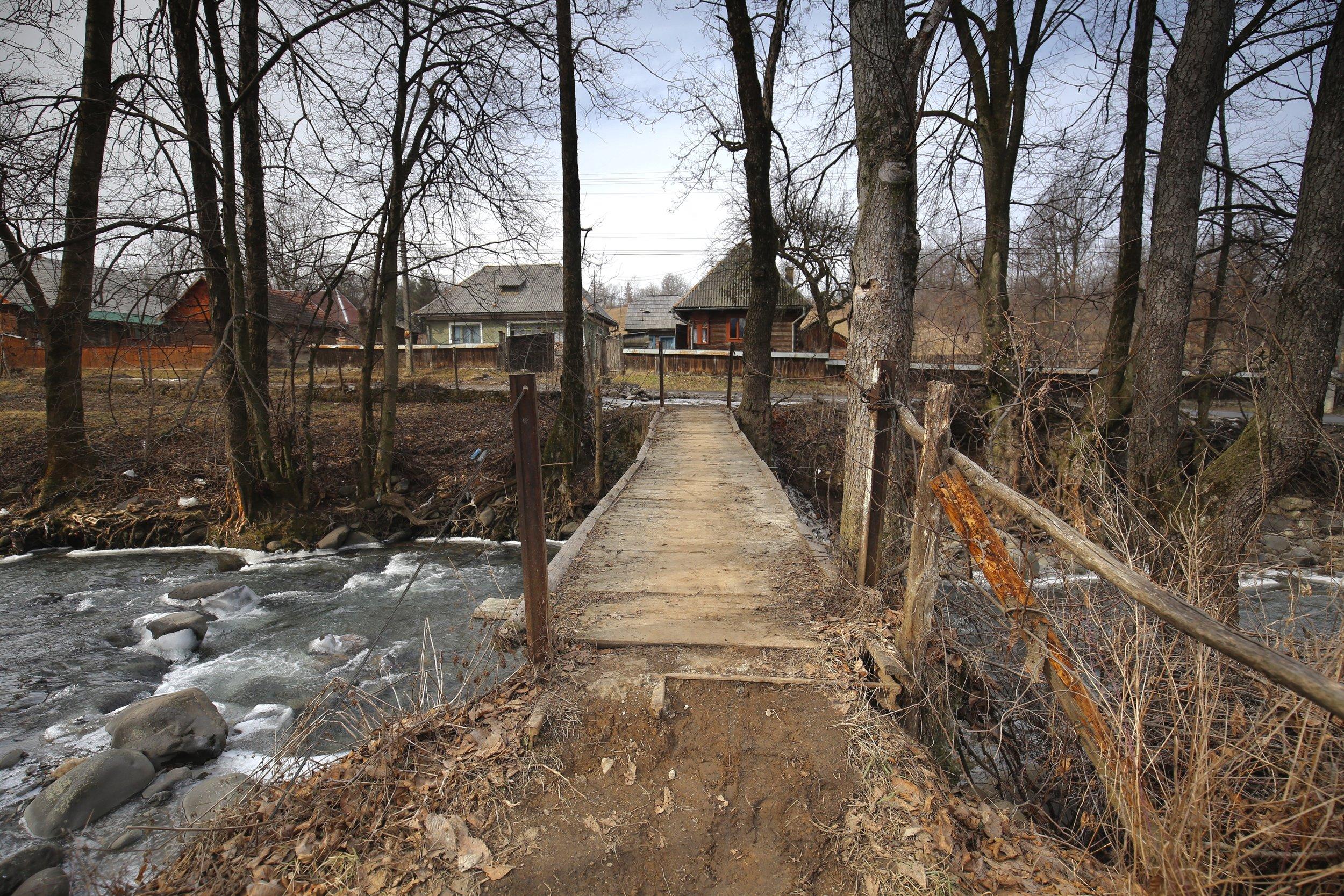 A bridge over a half frozen river, in Maramures.