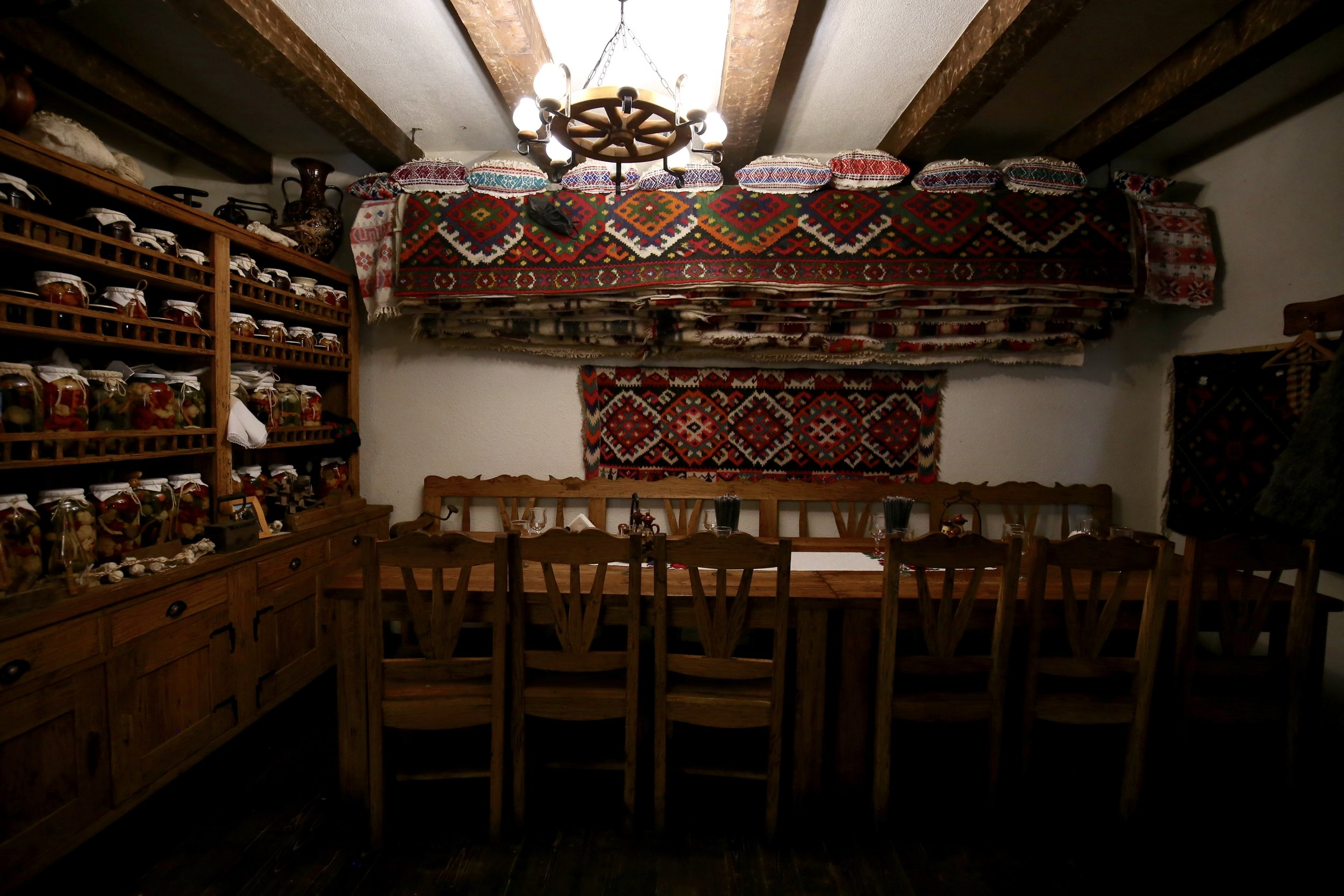 Pastravaria Alex - a small traditional Romanian restaurant with colourful carpets and low ceilings.