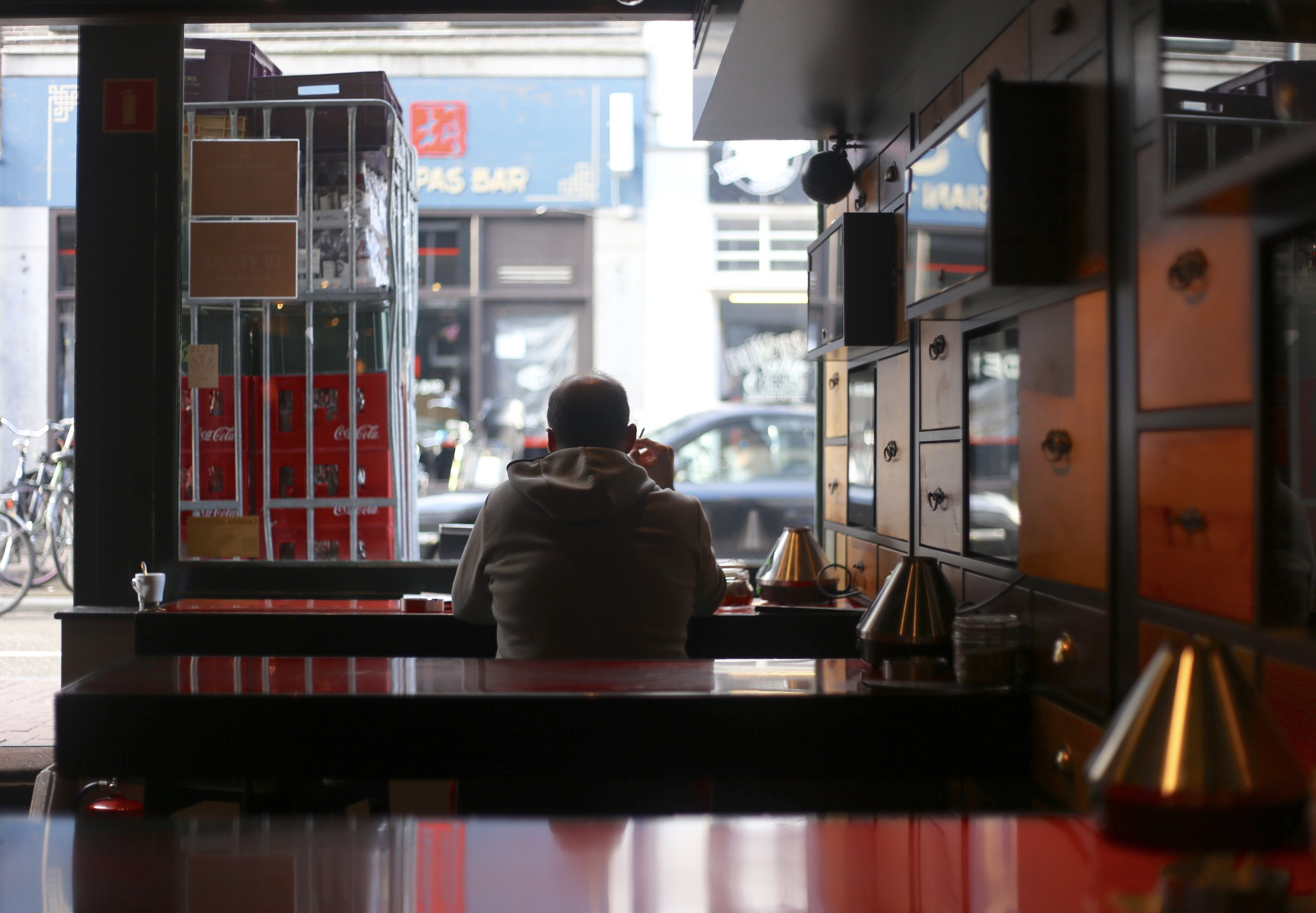 Guy sitting in a coffee shop, smoking and musing on life.