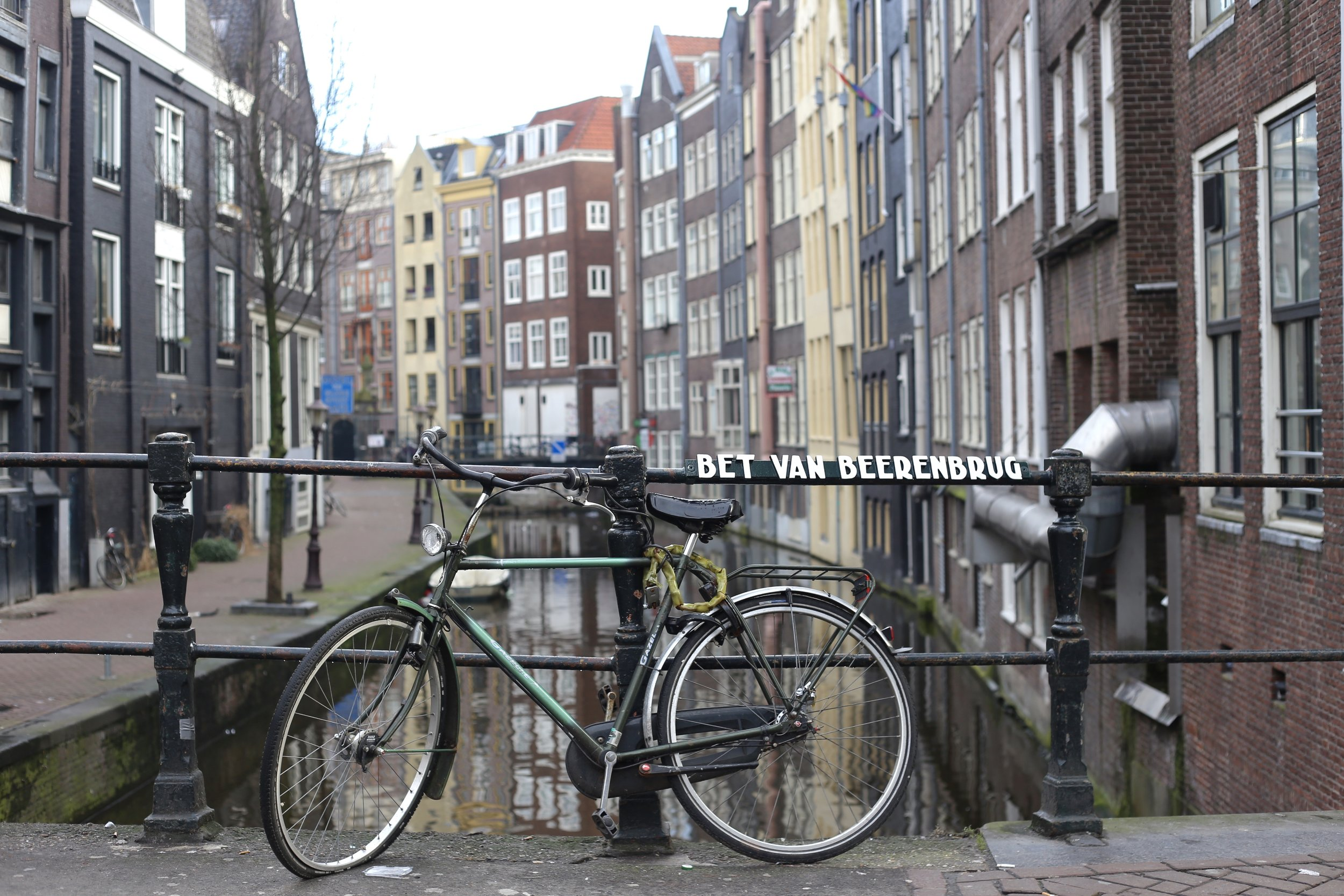 A bike set on a bridge over a canal - picturesque moment.