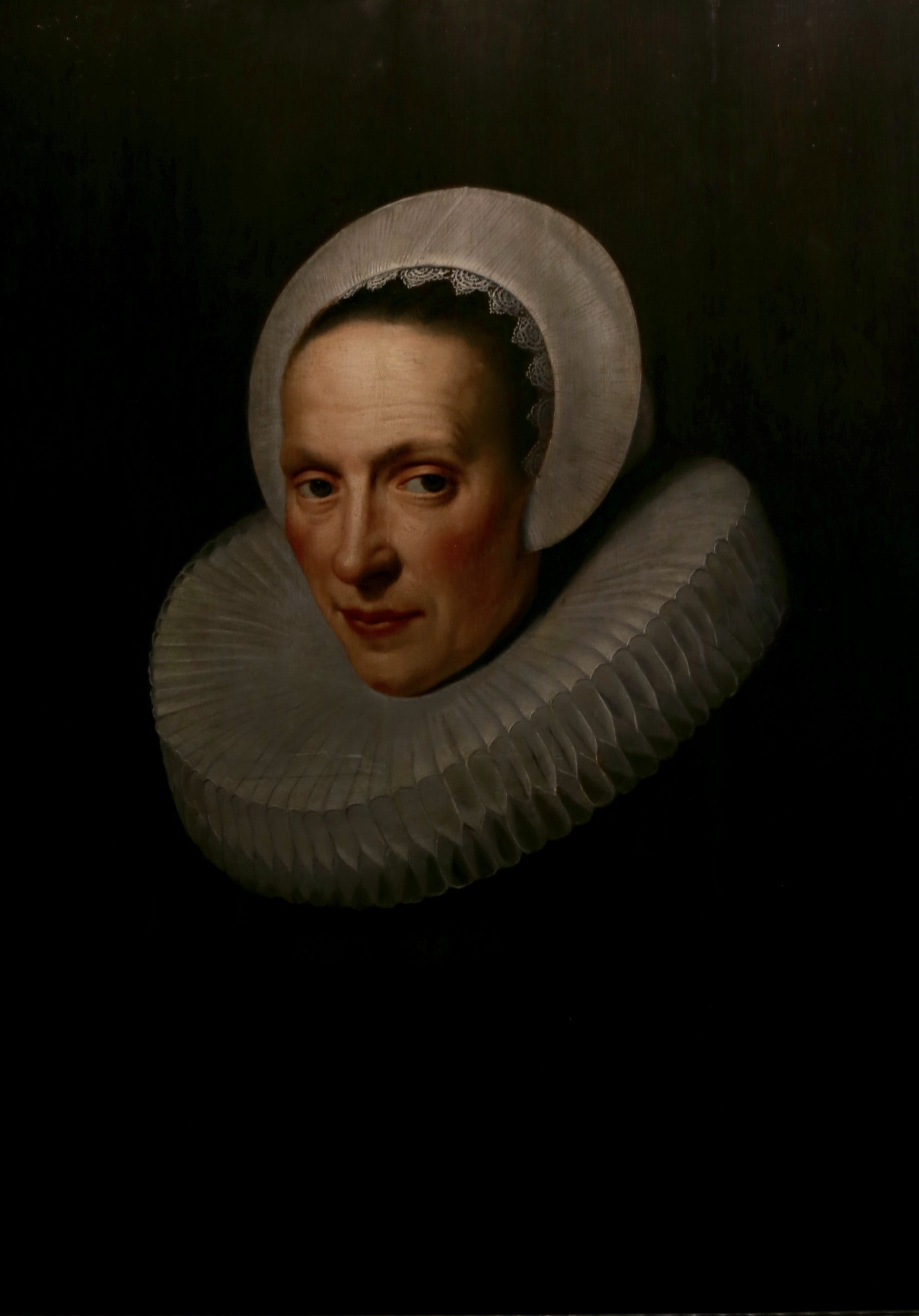 Old dutch painting of a lady with a stiff neck ruff.