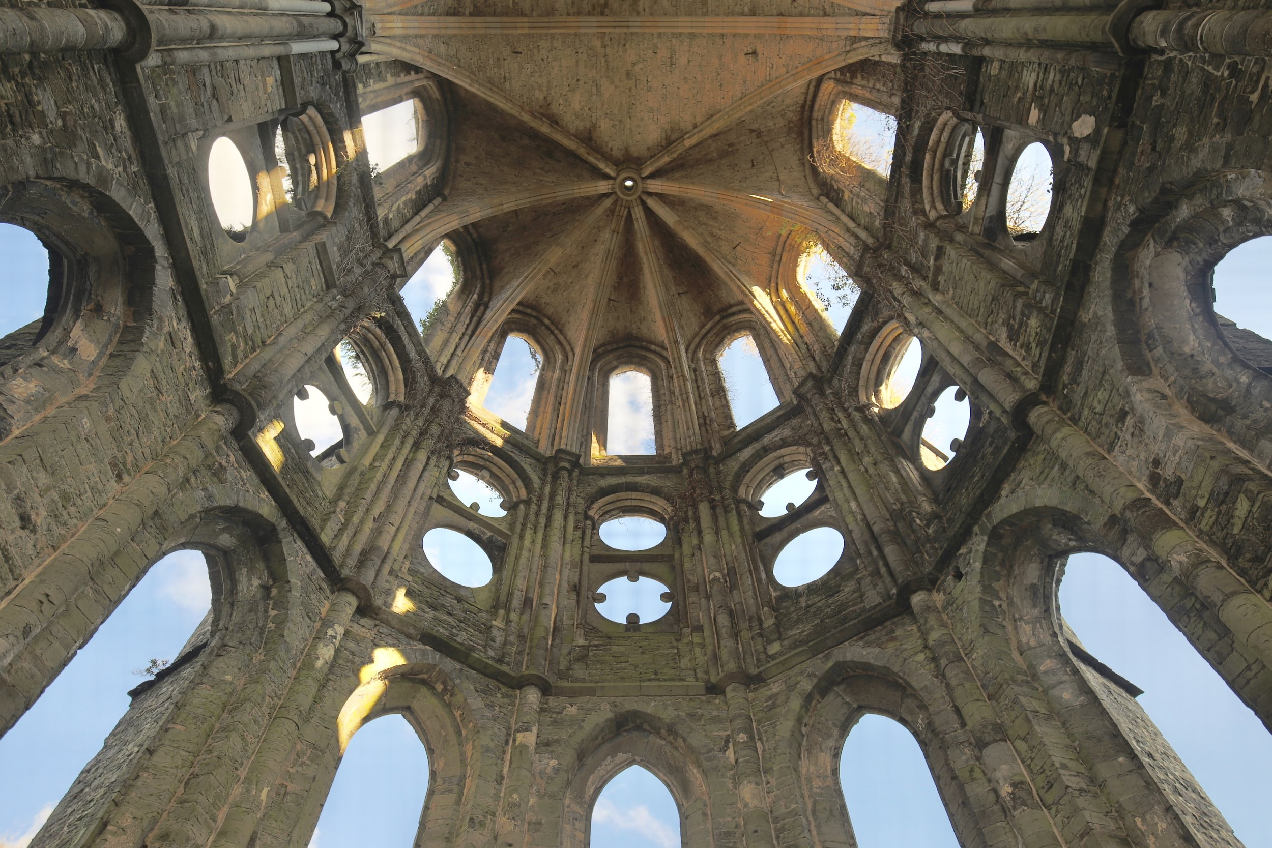 The beautiful stone apse of Abbaye de Villers - with light pouring in.