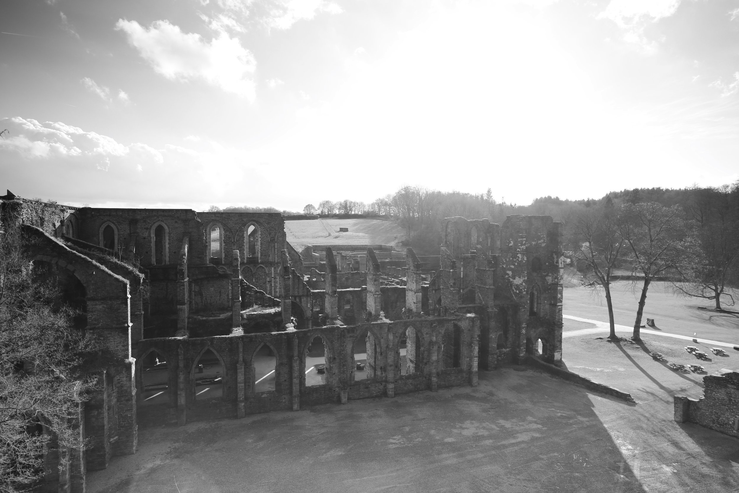 Black and white photo of Abbaye de Villers, Belgium - in afternoon sun.