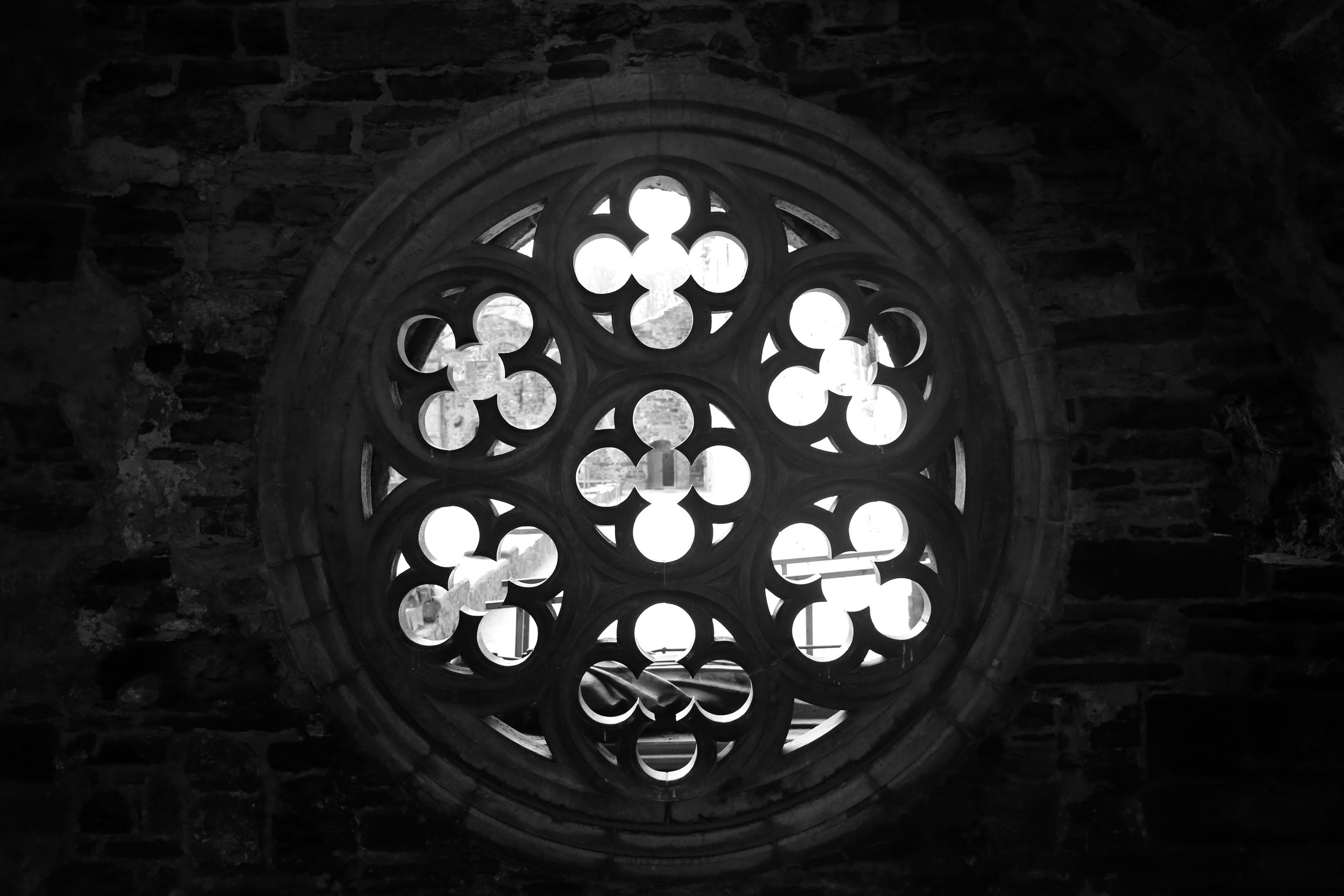 Round window with stone tracery, in an old Abbey of Belgium.
