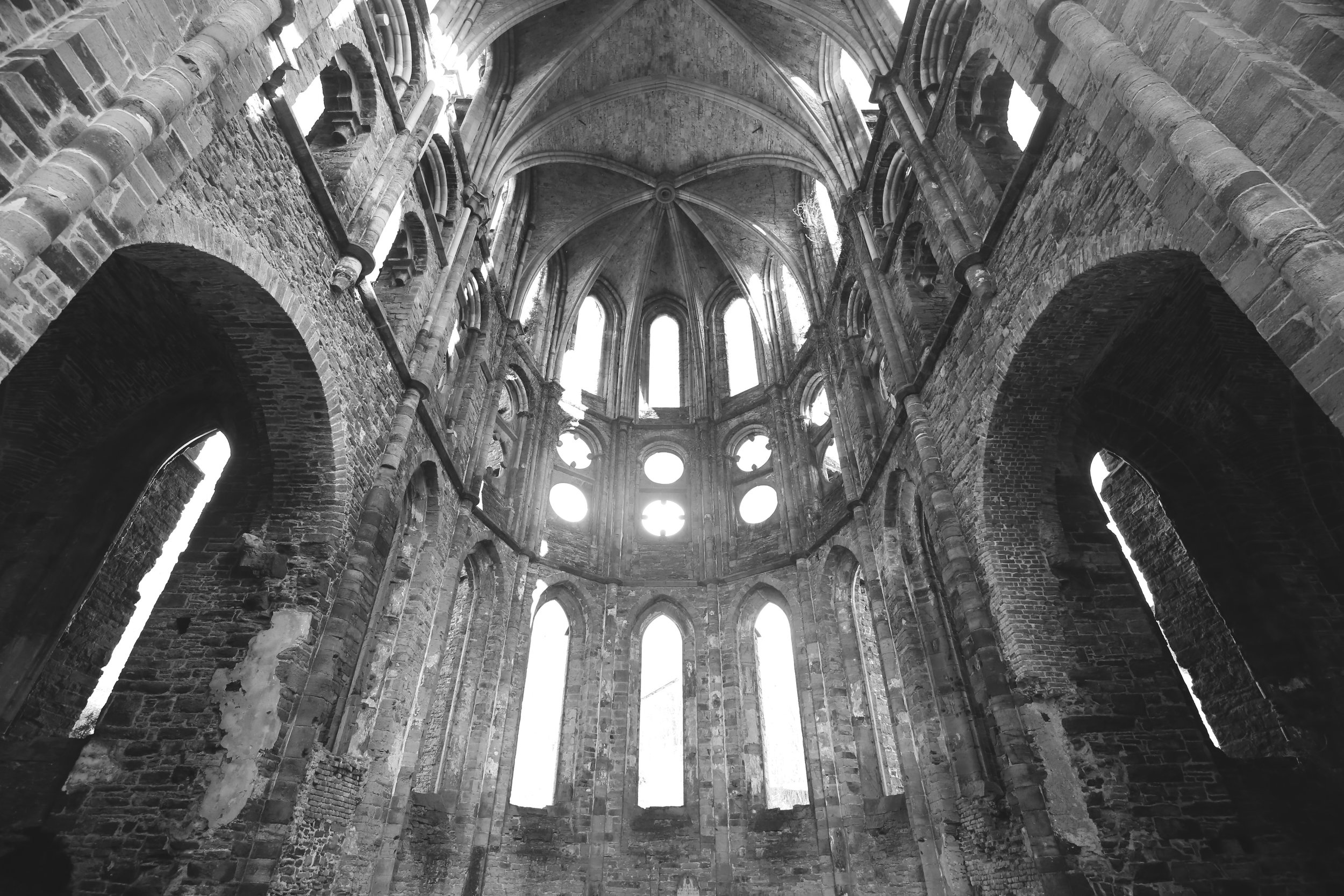 Light pours through the windows in the old stone apse.