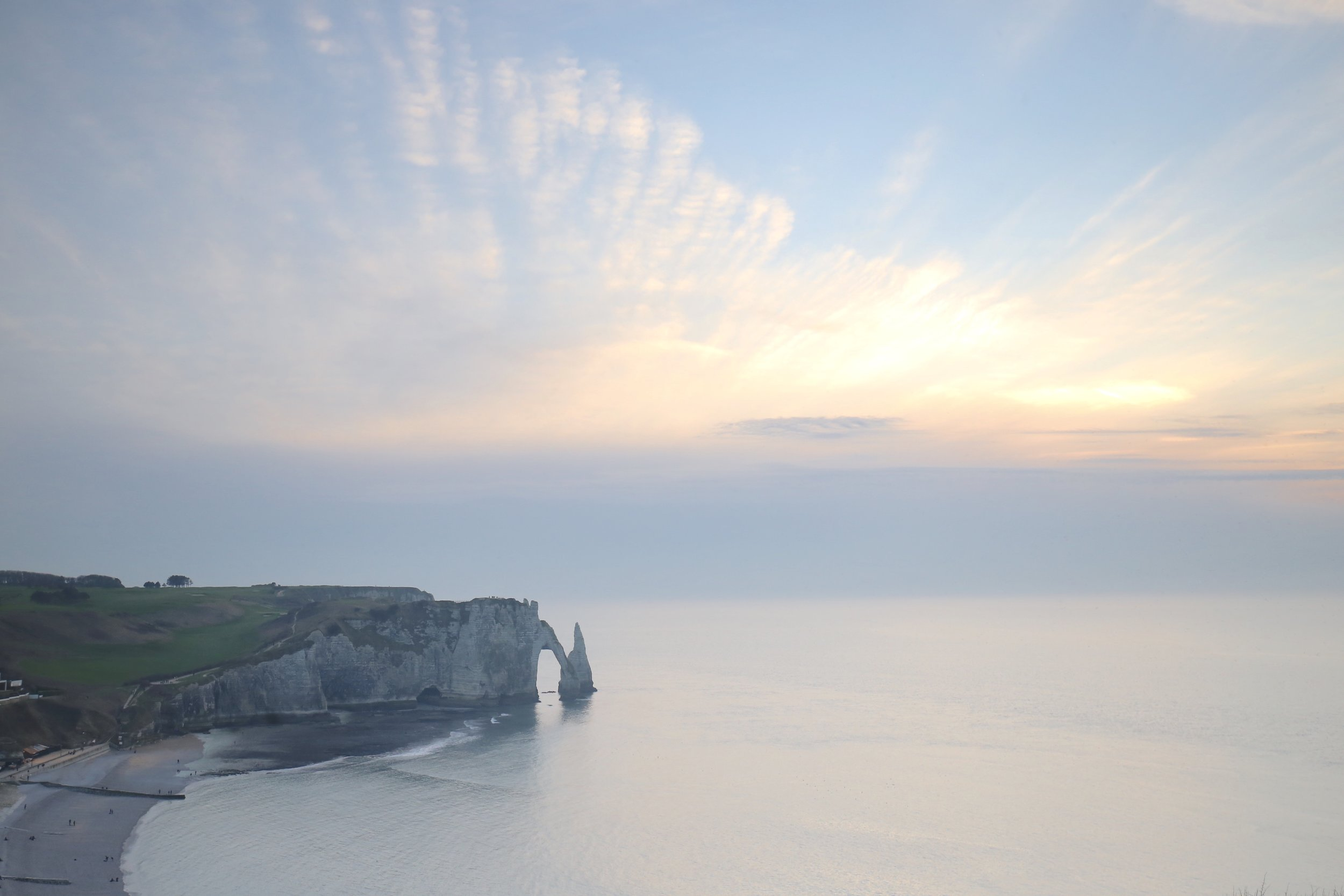 Sunset over the cliffs of Etretat, France - like a painting by Monet.