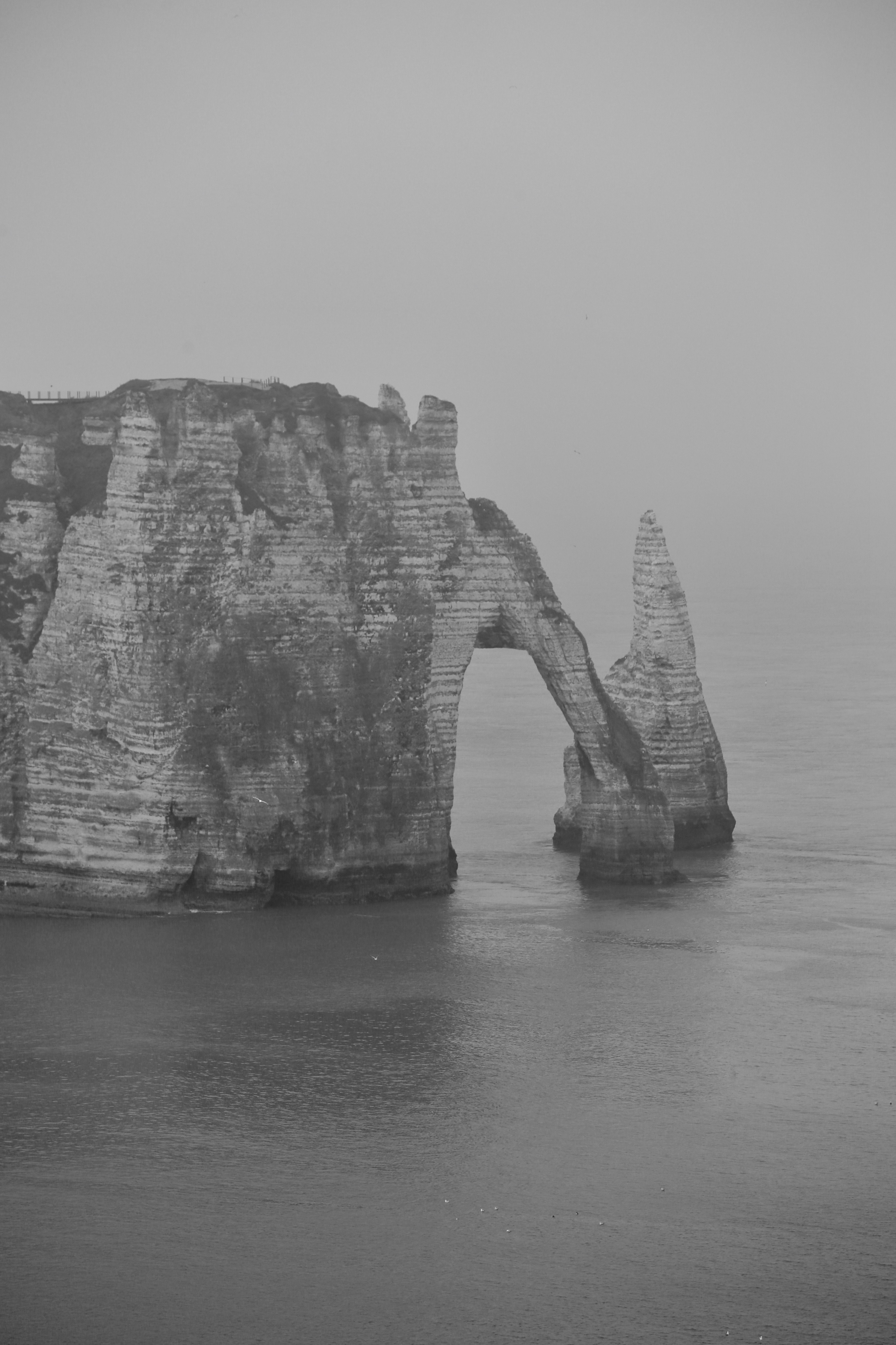 A natural arch in the cliffs by the sea, Etretat, France.