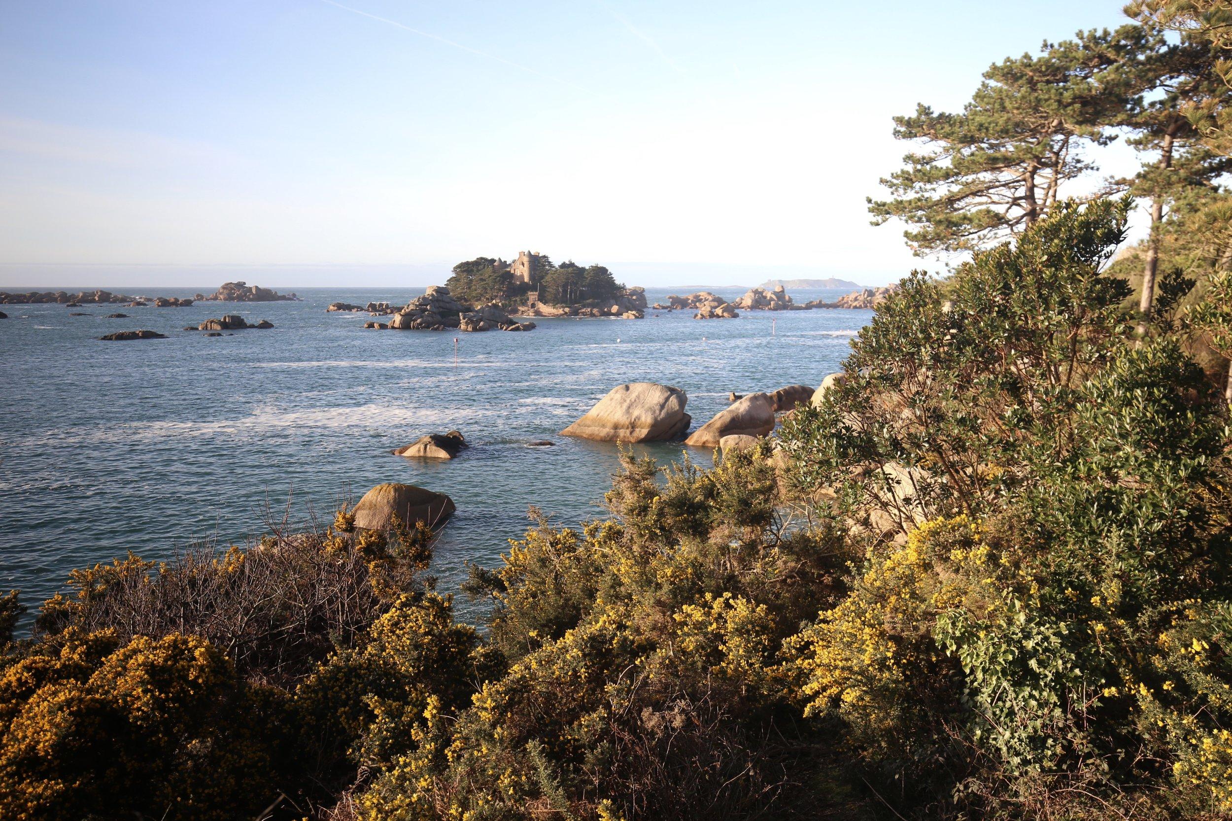 Castles on islands and lush foliage on the Granite Rose Coast.