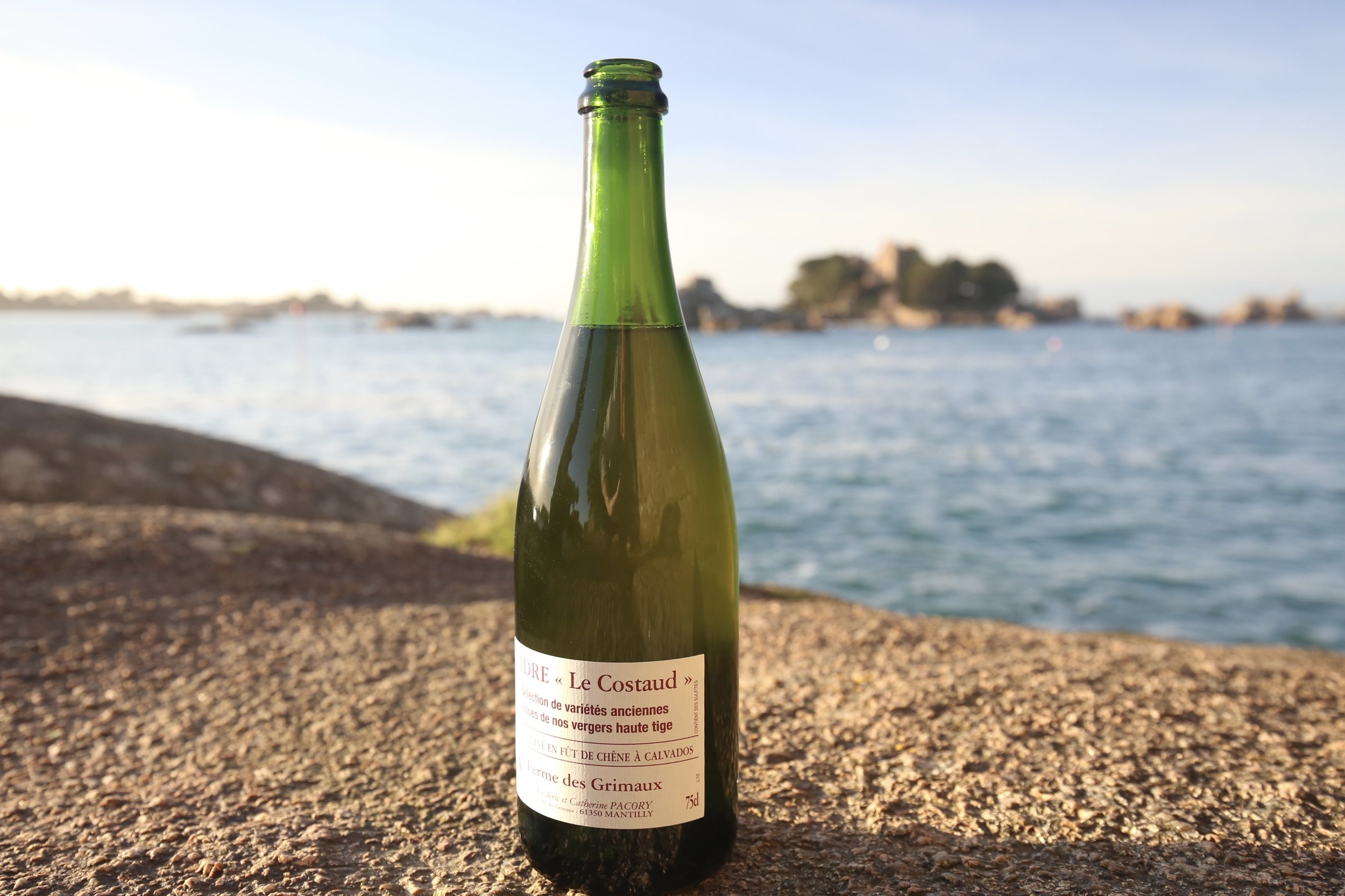 A bottle of real French cider from Brittany, picnic on the Rose Coast of France.