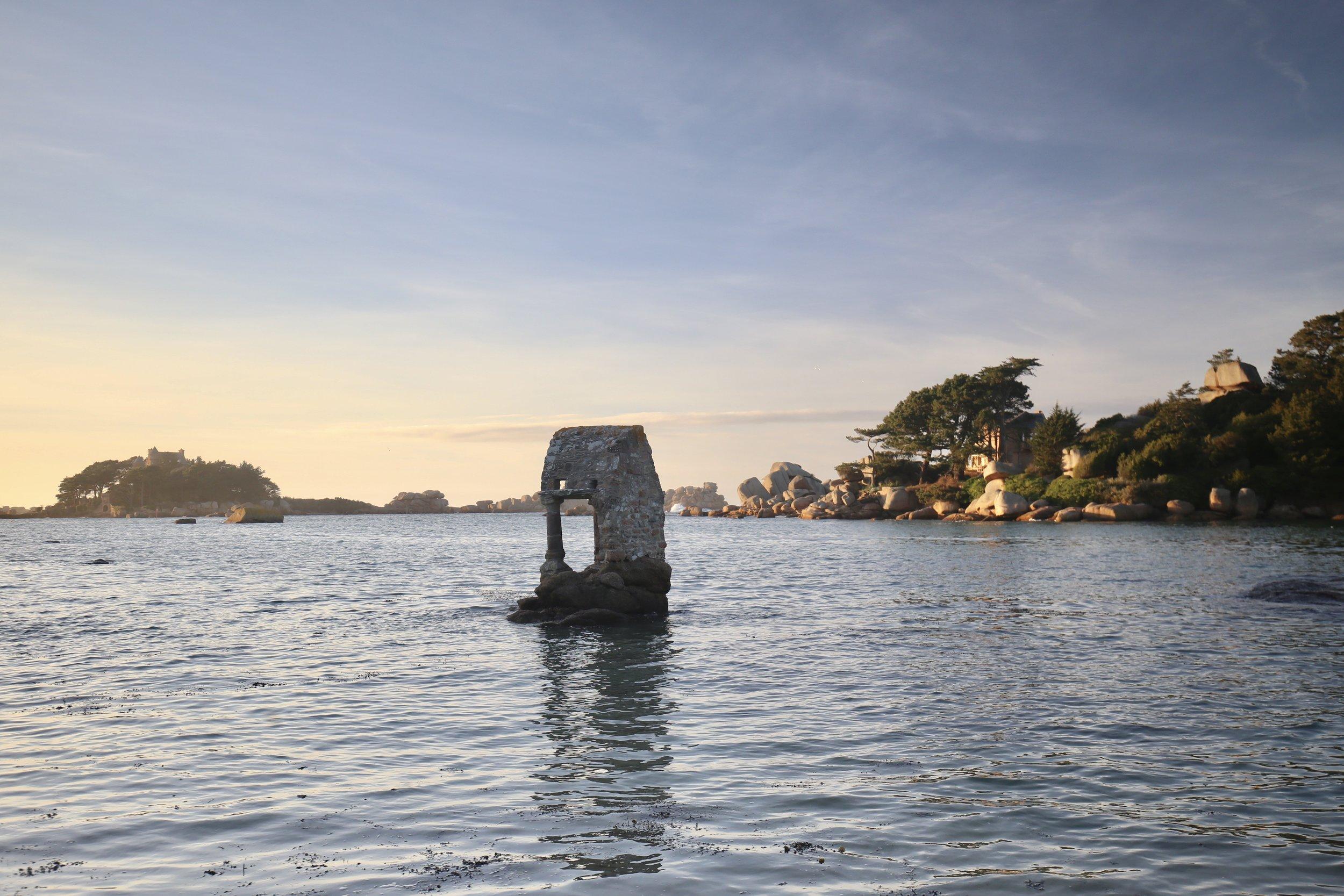 Shrine in the waters - a stone sea shrine.